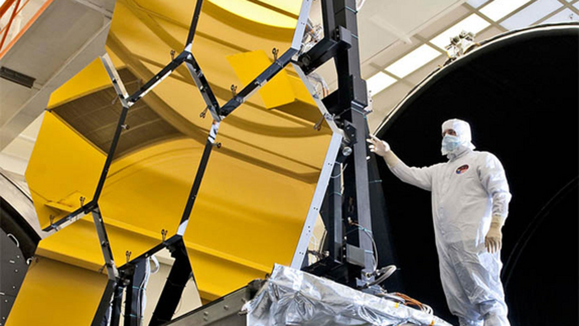An engineer inspects the JWST's primary mirror segments at NASA's Marshall Space Flight Center in Huntsville,