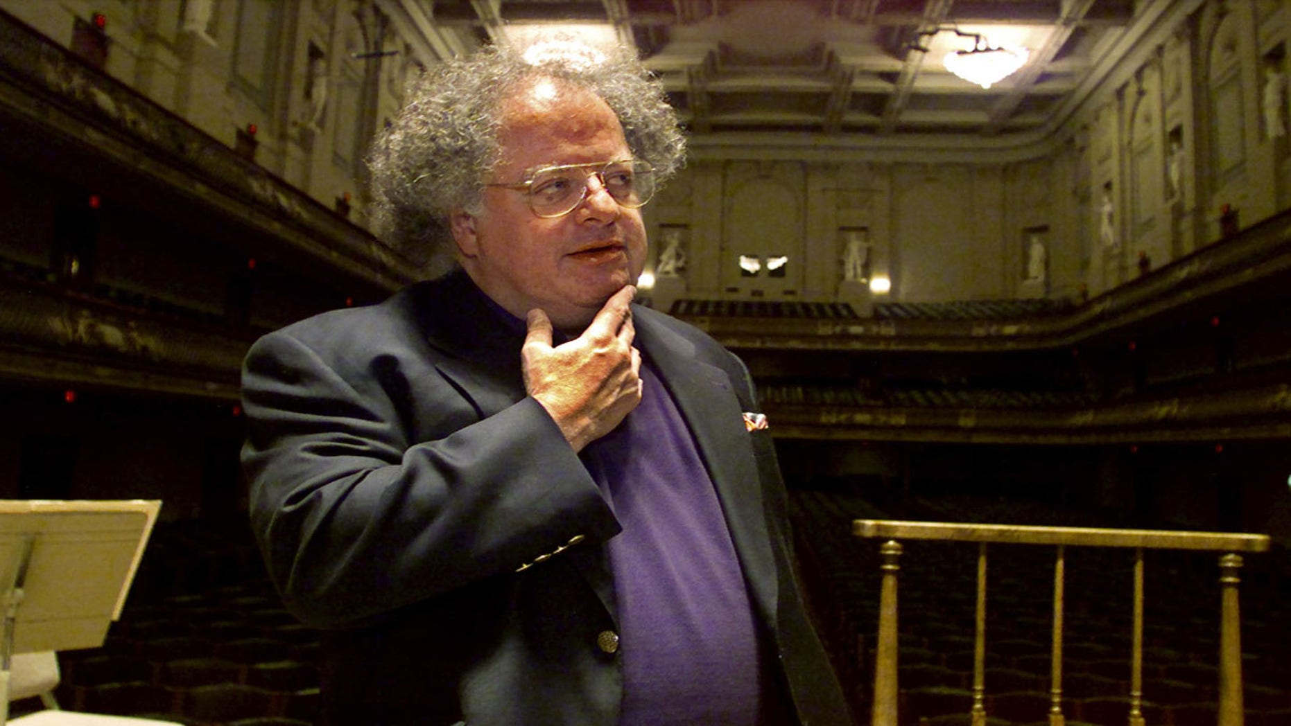 James Levine was accused of sexually harassing a minor by a former music student. Here Levine stands at the conductor's podium at Boston's Symphony Hall in 2001.