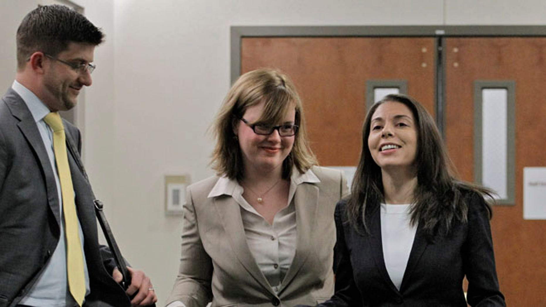 FoxNews.com reporter Jana Winter, right, and her attorneys are shown after the New York Court of Appeals threw out a subpoena requiring her to go to Colorado and reveal sources for an exclusive story or face jail.