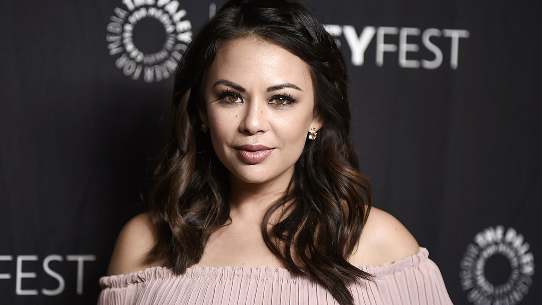 """FILE - In this March 25, 2017, file photo, Janel Parrish attends the 34th annual PaleyFest: """"Pretty Little Liars"""" event at the Dolby Theatre in Los Angeles. Parrish and longtime boyfriend Chris Long have gotten married. The wedding took place Saturday, Sept. 8, 2018, in Hawaii, where she was born. (Photo by Richard Shotwell/Invision/AP, File)"""