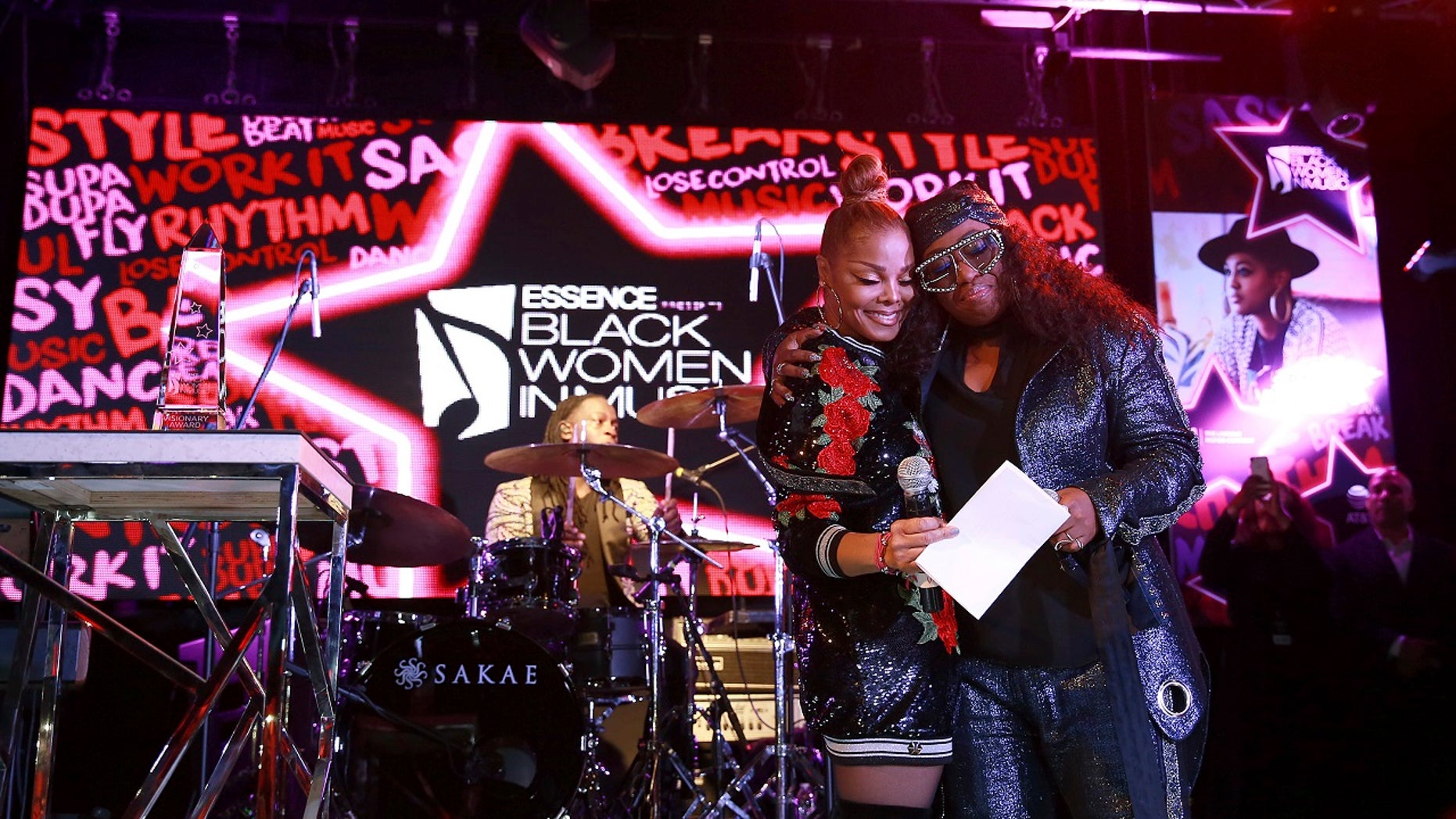 Janet Jackson, left, and Missy Elliott share a moment onstage at the ninth annual Essence Black Women in Music event at the Highline Ballroom in New York City, Jan. 25, 2018.