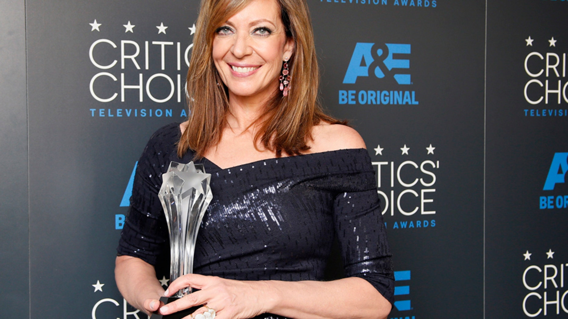 """Actress Allison Janney poses backstage with her award for Best Supporting Actress - Comedy for her role on the CBS sitcom """"Mom"""" during the 5th Annual Critics' Choice Television Awards in Beverly Hills, California May 31, 2015."""