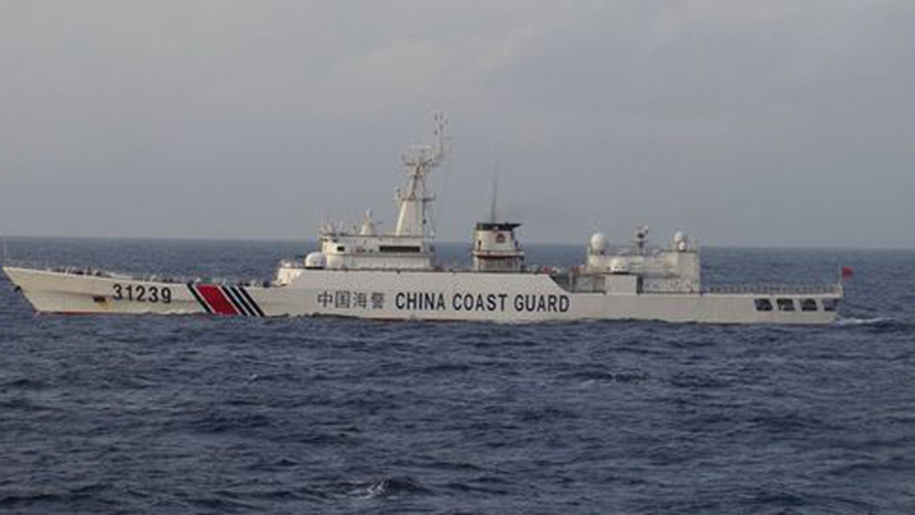 An armed Chinese coast guard ship sails in the water off islands claimed by Japan and China, on Tuesday.(Photo: Japan Coast Guard via AP)