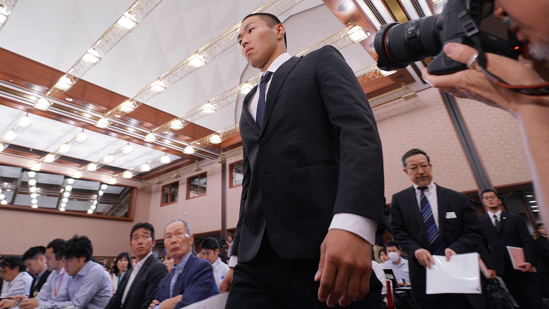 Nihon University's American football player Taisuke Miyagawa arrives for a news conference.