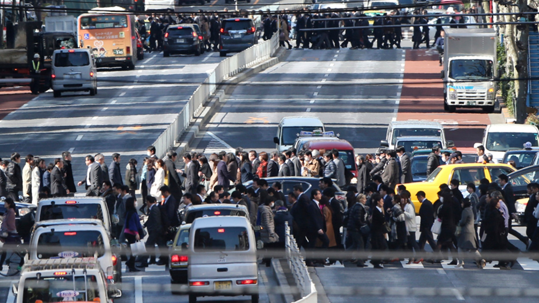 Feb. 26, 2016: People cross crosswalks on a street in Tokyo.