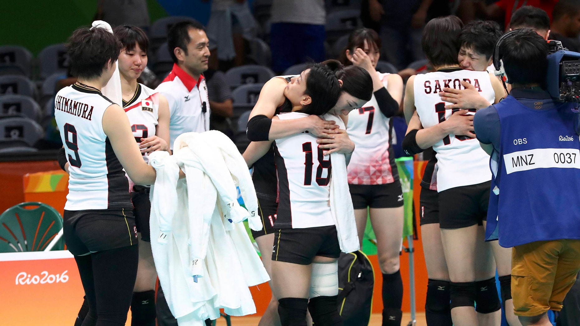 File photo: 2016 Rio Olympics - Volleyball Women's Quarterfinals - Japan v USA - Maracanazinho - Rio de Janeiro, Brazil - 16/08/2016. Japanese team players reacts after losing to the USA. (REUTERS/Yves Herman)