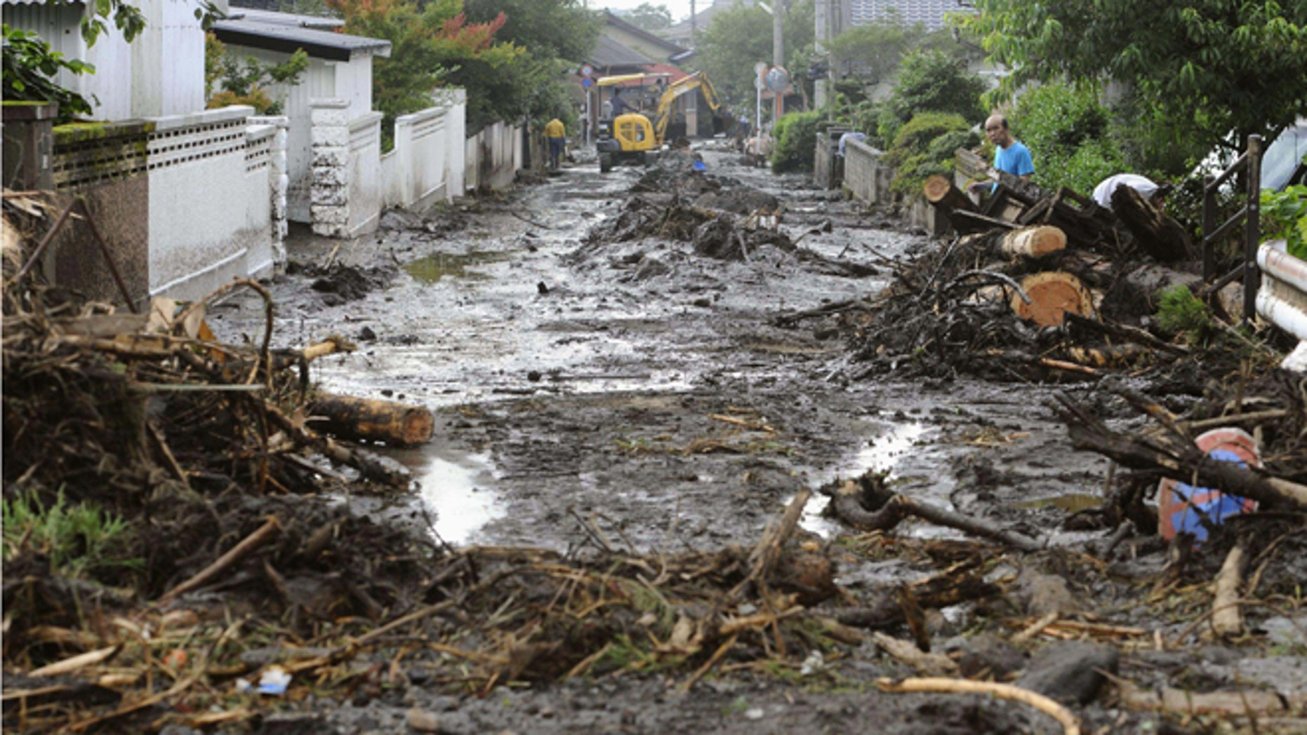 July 12, 2012: A road is covered with mud and woods carried by a mudslide in Aso, Kumamoto Prefecture, western Japan.