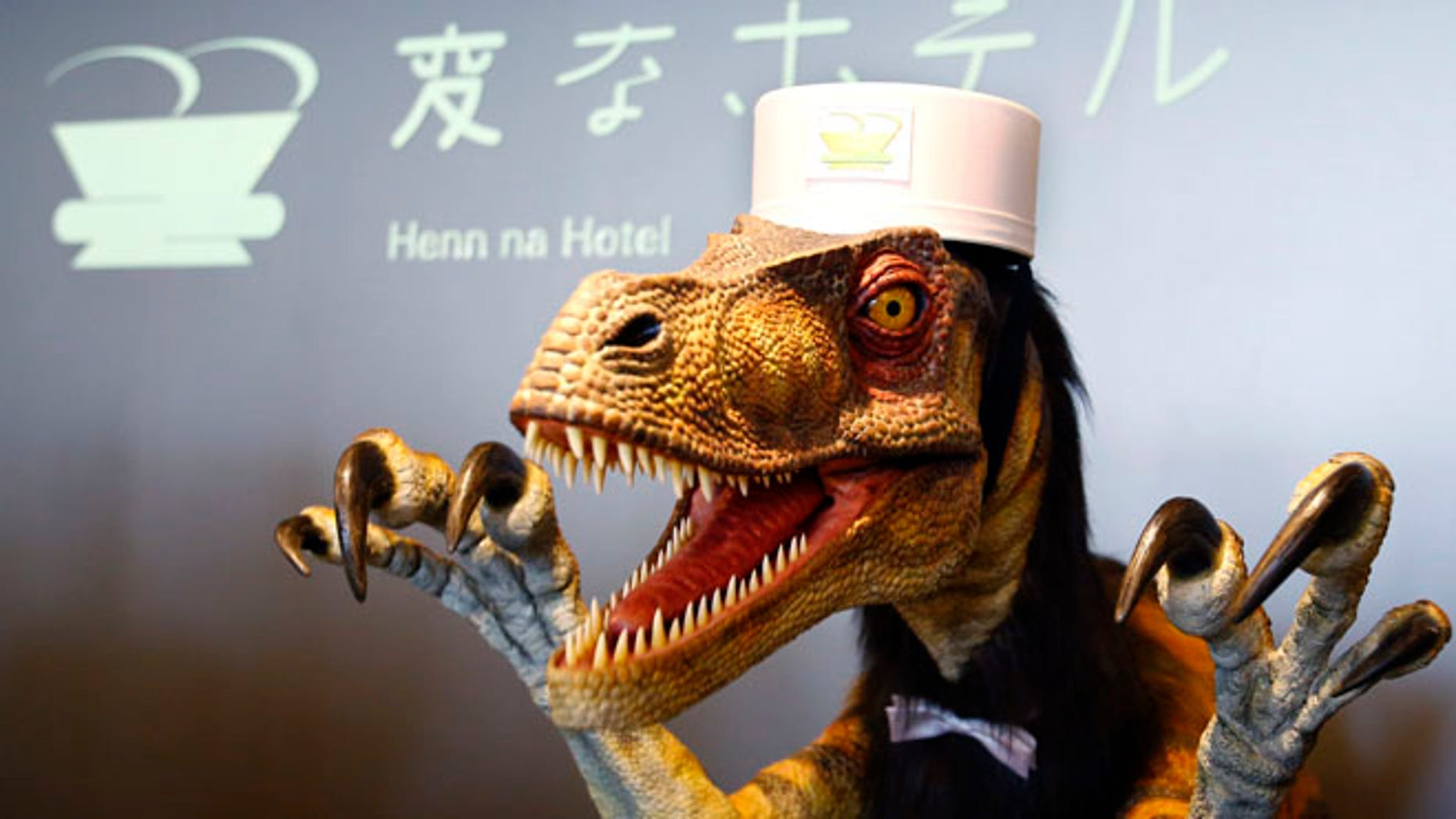 A receptionist dinosaur robot performs at a new hotel, aptly called Henn na Hotel or Weird Hotel, in Sasebo, southwestern Japan.
