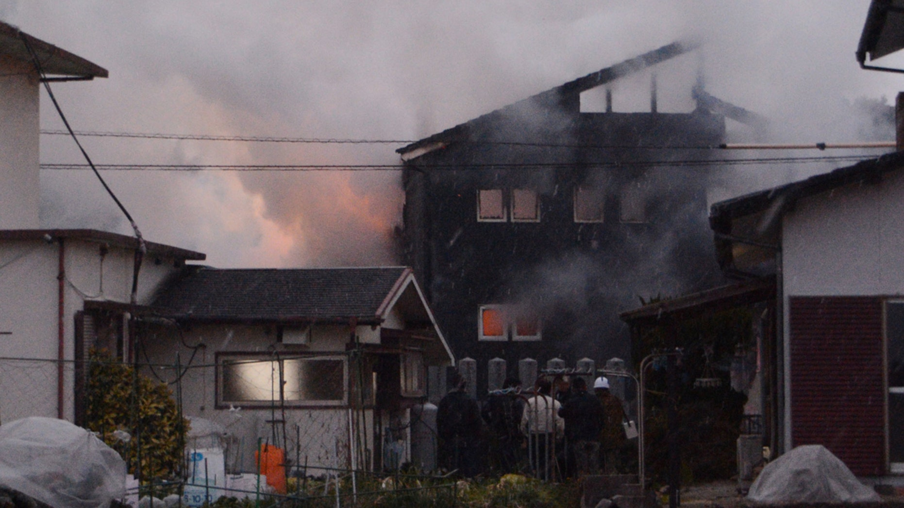 Smoke billows from the site where a Japanese military helicopter crashed in Kanzaki on Monday.