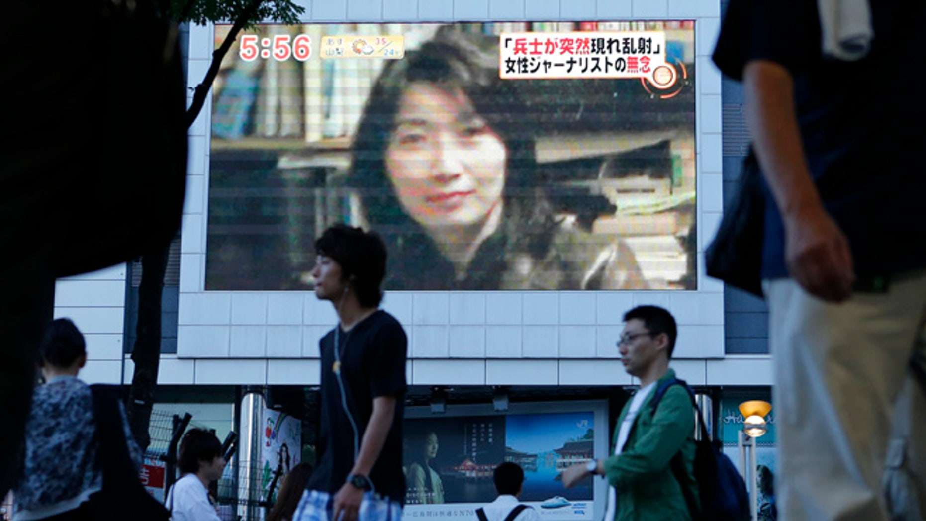 Aug. 21, 2012: An image of Japanese journalist Mika Yamamoto is shown on a large monitor screen in Tokyo during a TV news broadcast reporting her death in Syria.