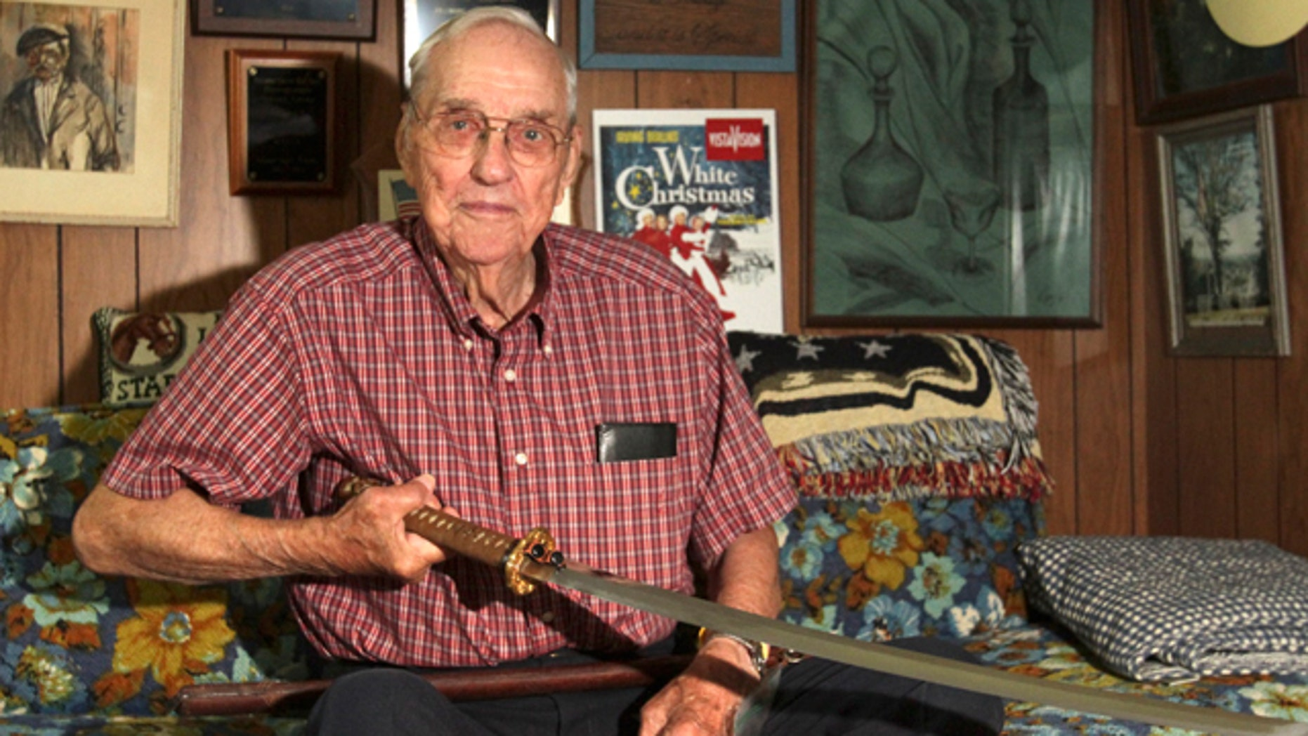 Sept. 10, 2013: Orval Amdahl, 94, of Lanesboro, Minn, holds a sword he took from Japan when he was a captain in the Marines in 1945, at his home in Lanesboro, Minn.