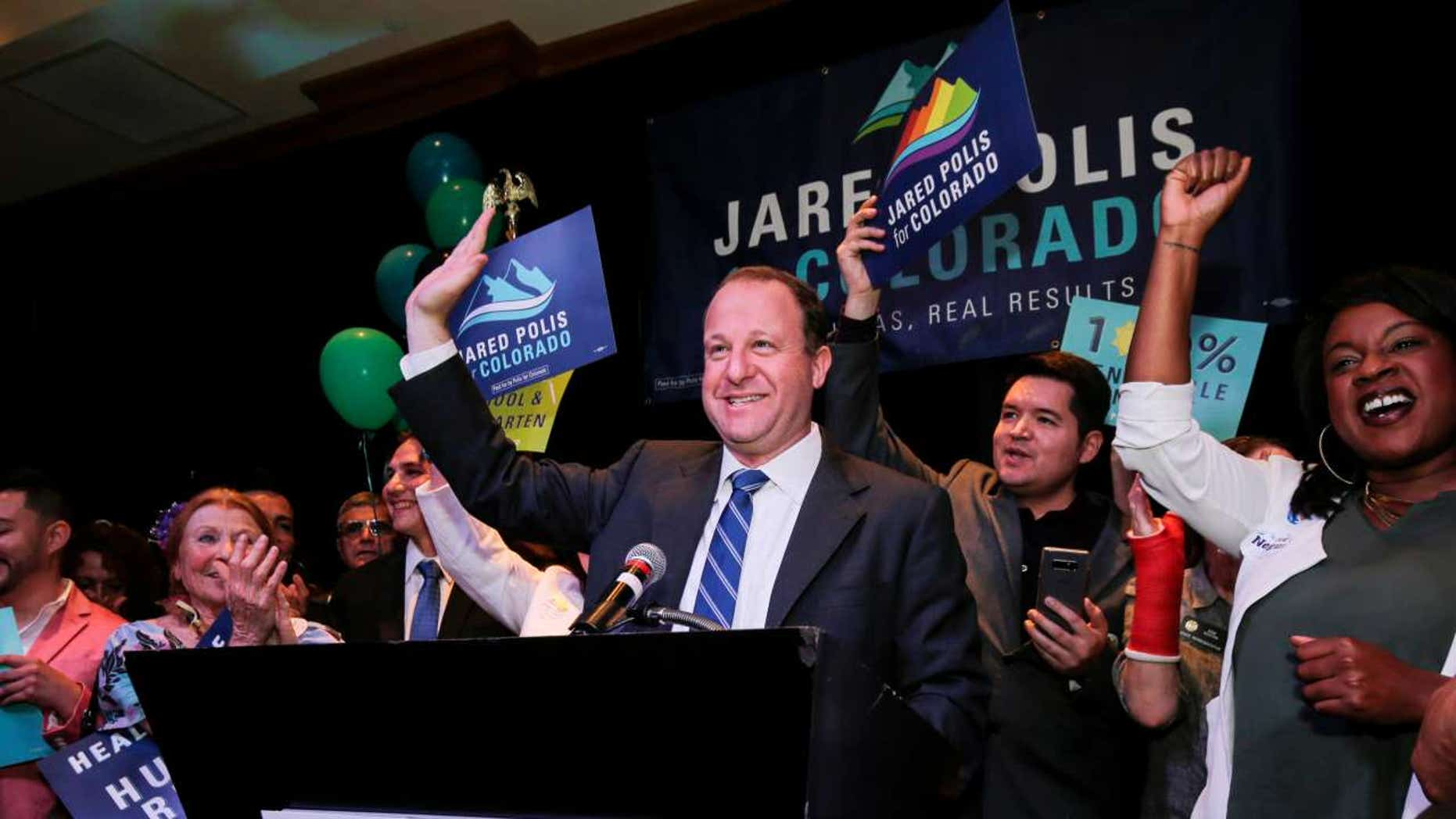 U.S. Rep Jared Polis waves to the crowd while accepting the Democratic nomination for the Colorado governor's race at an election night rally in Broomfield, Colo. , June 26, 2018.