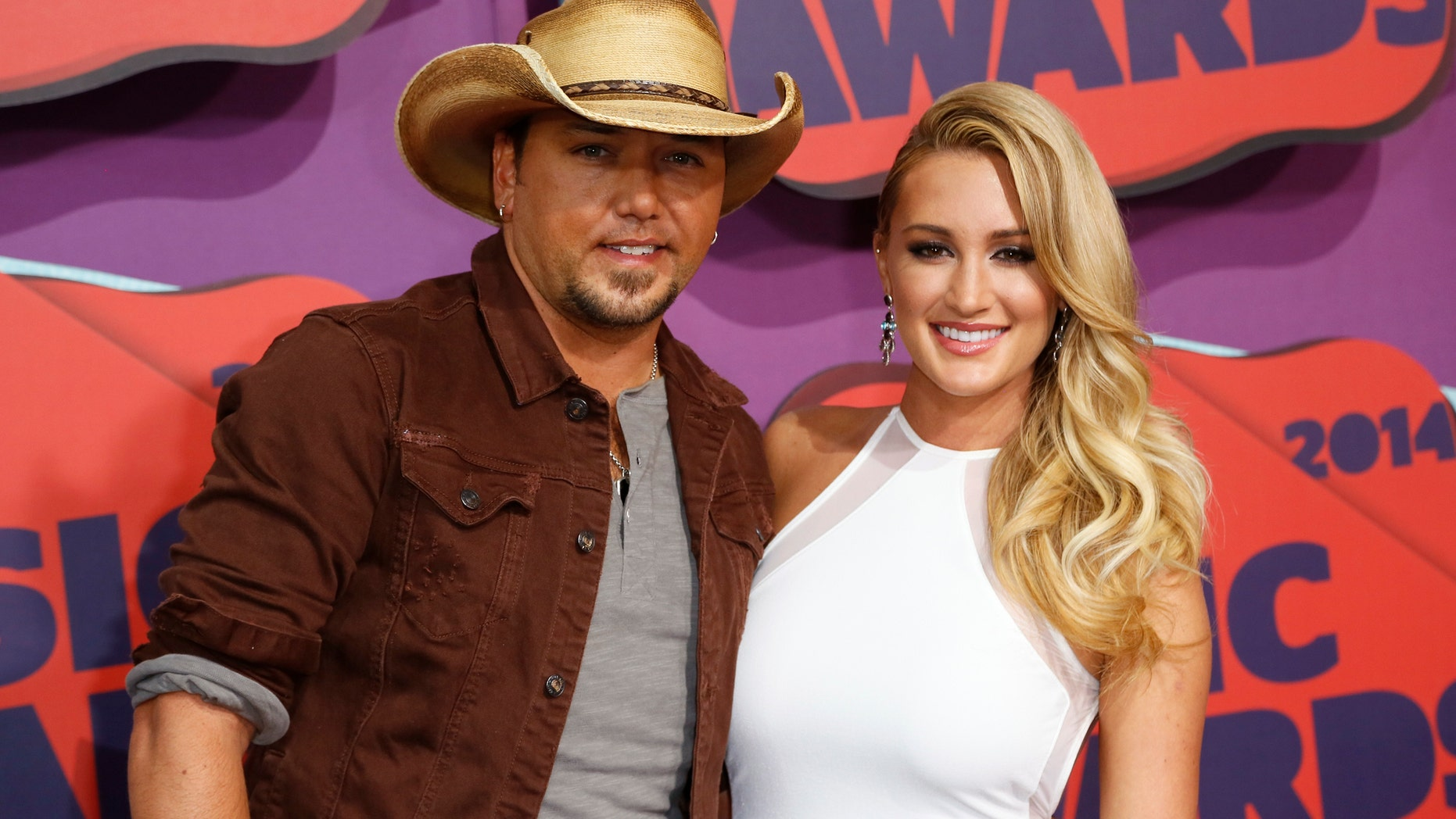 Musician Jason Aldean and Brittany Kerr arrive at the 2014 CMT Music Awards in Nashville, Tennessee June 4, 2014.
