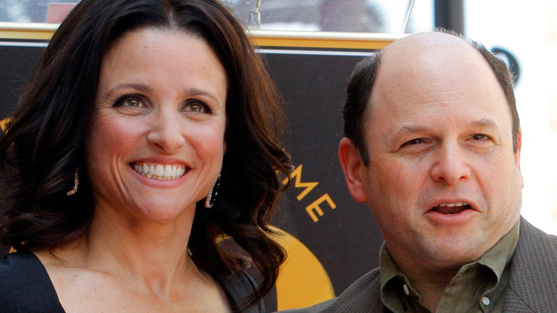 """Actress Julia Louis-Dreyfus (L) poses with """"Seinfeld"""" co-star Jason Alexander at a ceremony to unveil her star on the Hollywood Walk of Fame in Hollywood, California May 4, 2010.   REUTERS/Fred Prouser   (UNITED STATES - Tags: ENTERTAINMENT) - RTR2DGQI"""