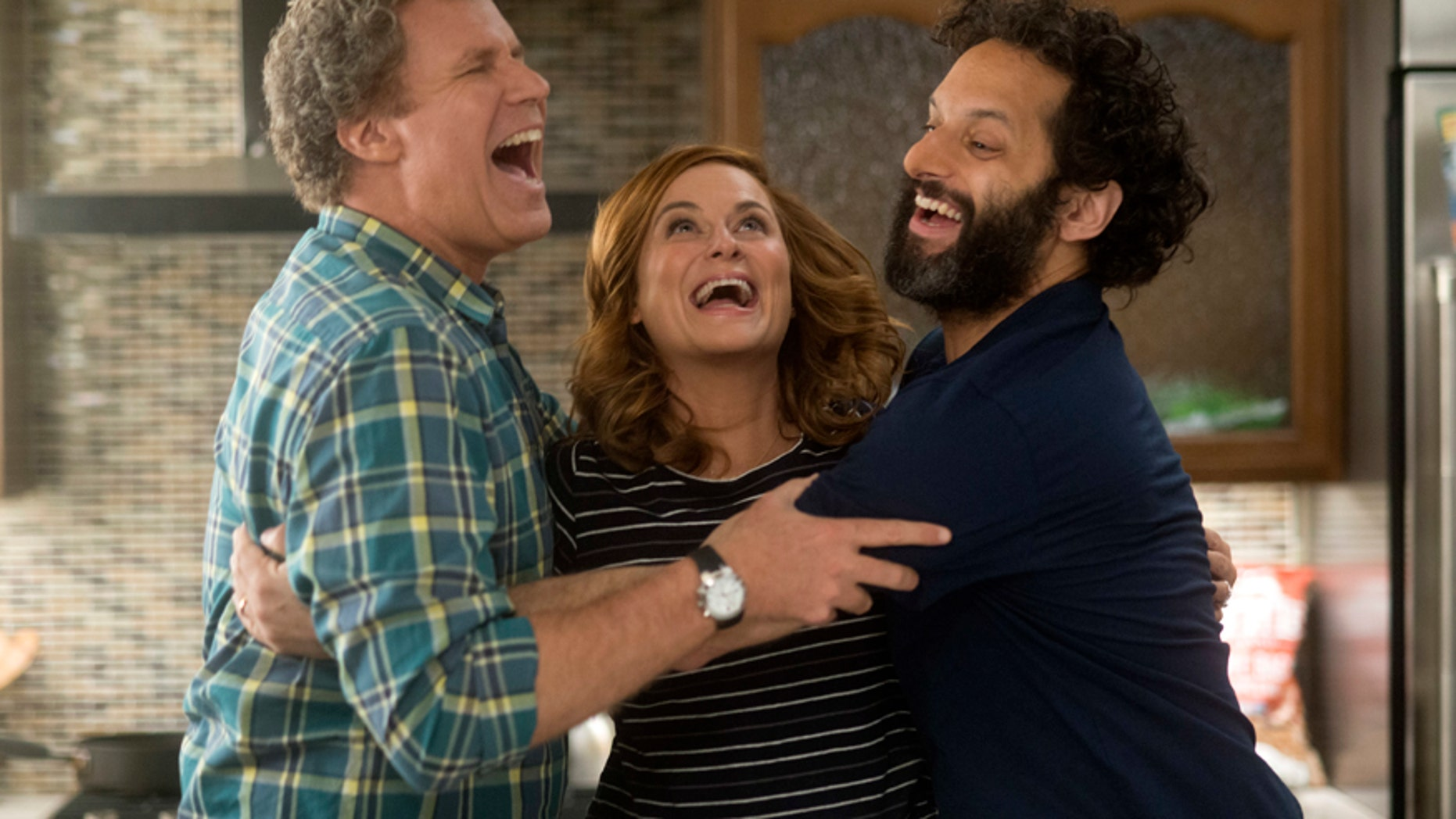 "This image released by Warner Bros Pictures shows, from left, Will Ferrell, Amy Poehler and Jason Mantzoukas in a scene from ""The House."""
