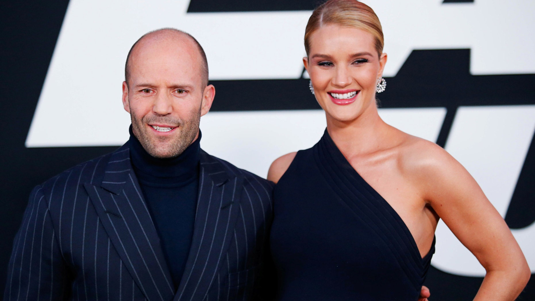 Jason Statham with his long-time partner, supermodel Rosie Huntington-Whiteley.