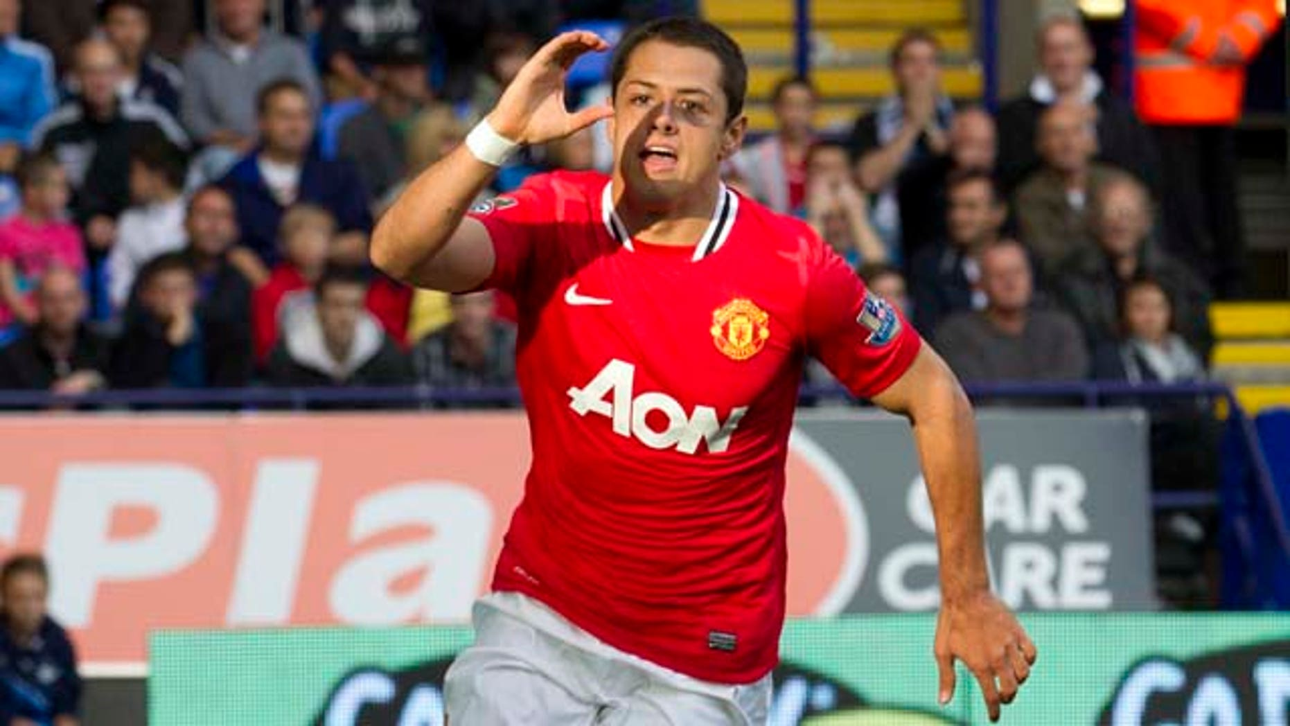 Manchester United's Javier Hernandez celebrates after scoring against Bolton during their English Premier League soccer match at The Reebok Stadium, Bolton, England, Saturday Sept. 10, 2011. (AP Photo/Jon Super)