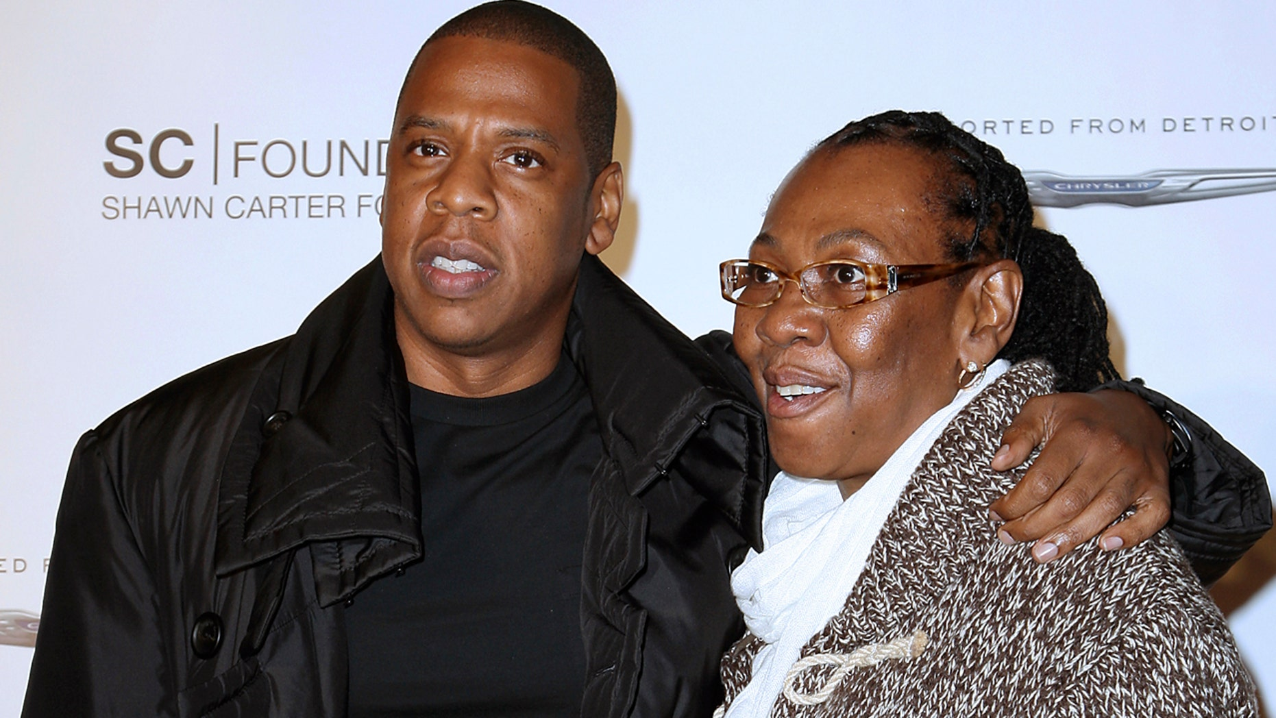 "FILE - In this Sept. 29, 2011 file photo released by Starpix, Shawn ""Jay Z"" Carter poses with his mother Gloria Carter at a fundraising event to support his college scholarship program in New York. The rapper speaks about his mother on the the April 6 episode of ""My Next Guest Needs No Introduction with David Letterman"" on Netflix. He says he cried when his mother came out to him and that he was happy that his mother was free. (AP Photo/Starpix, Kristina Bumphrey, File)"