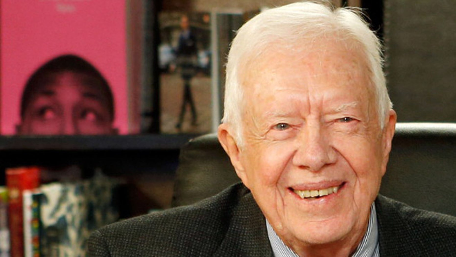 Former US President Jimmy Carter poses for a photo as he promotes his new book at Barnes & Noble, 5th Avenue on March 25, 2014 in New York City.