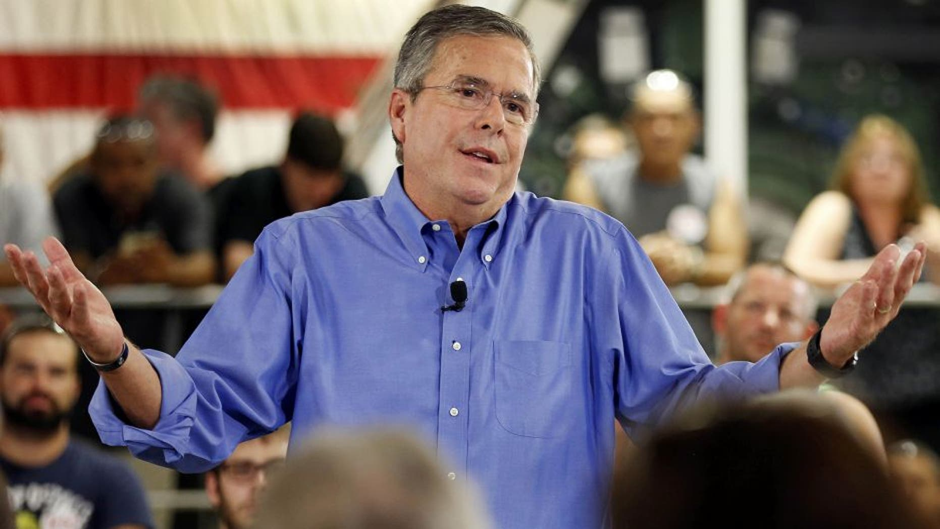 Republican presidential candidate former Florida Gov. Jeb Bush a speaks to employees at Foss Manufacturing during campaign stop Thursday, Sept. 3, 2015, in Hampton. N.H. (AP Photo/Jim Cole)