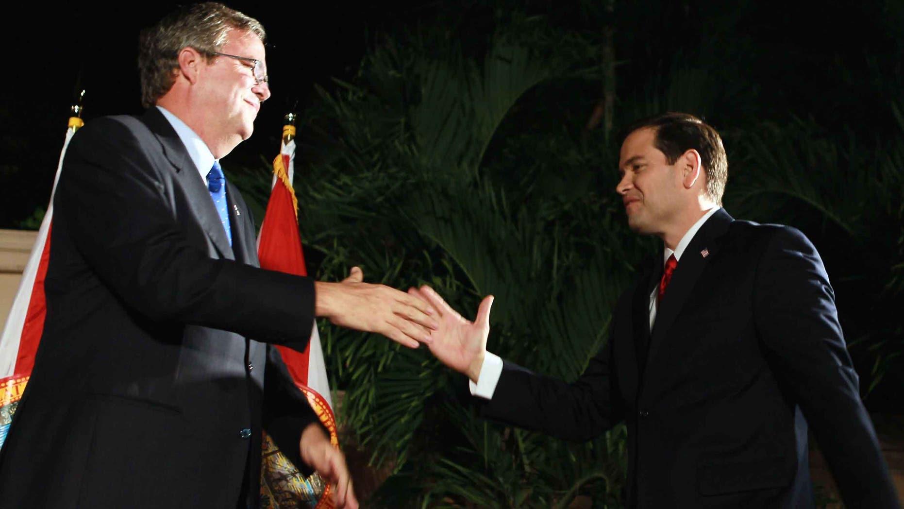 Sen. Marco Rubio  and former Gov. Jeb Bush in a 2010 file photo in Coral Gables, Florida.