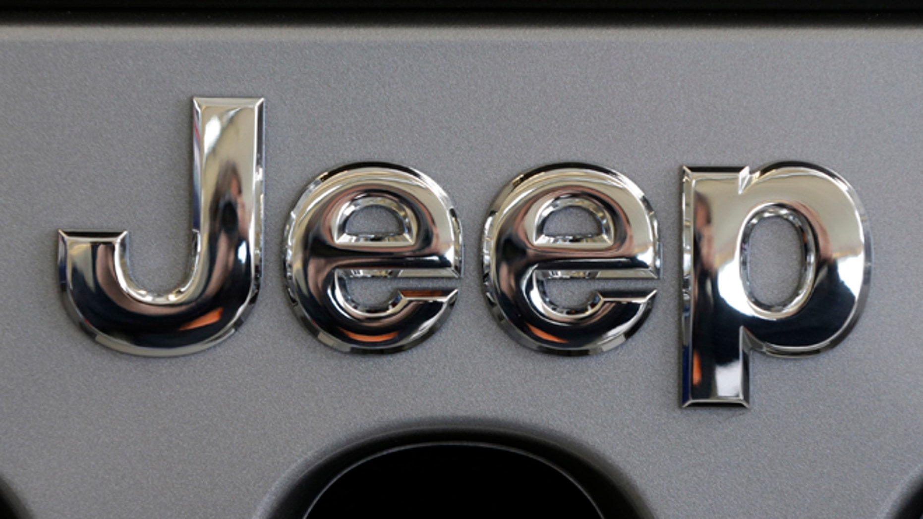 Feb. 14, 2013: A Jeep logo is shown on the grill of a Jeep Wrangler at the 2013 Pittsburgh Auto Show in Pittsburgh.