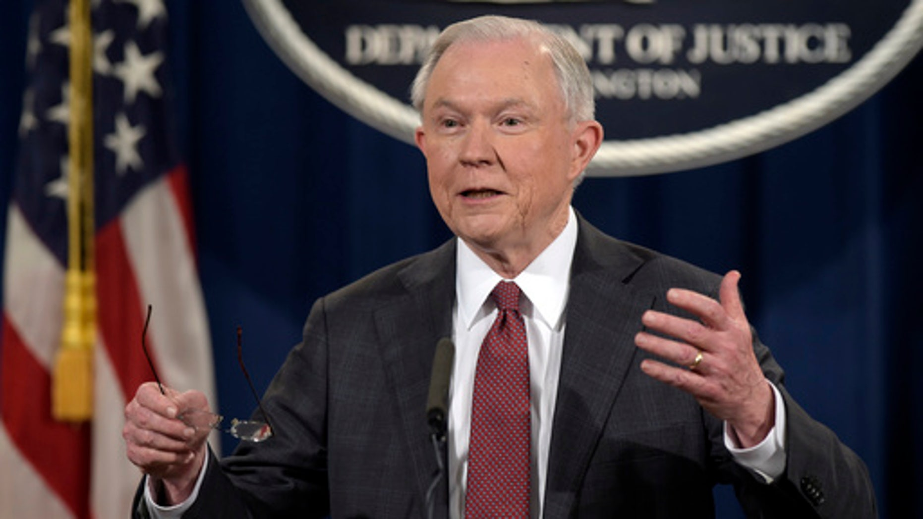 In this March 2, 2017, photo, Attorney General Jeff Sessions speaks during a news conference at the Justice Department in Washington.