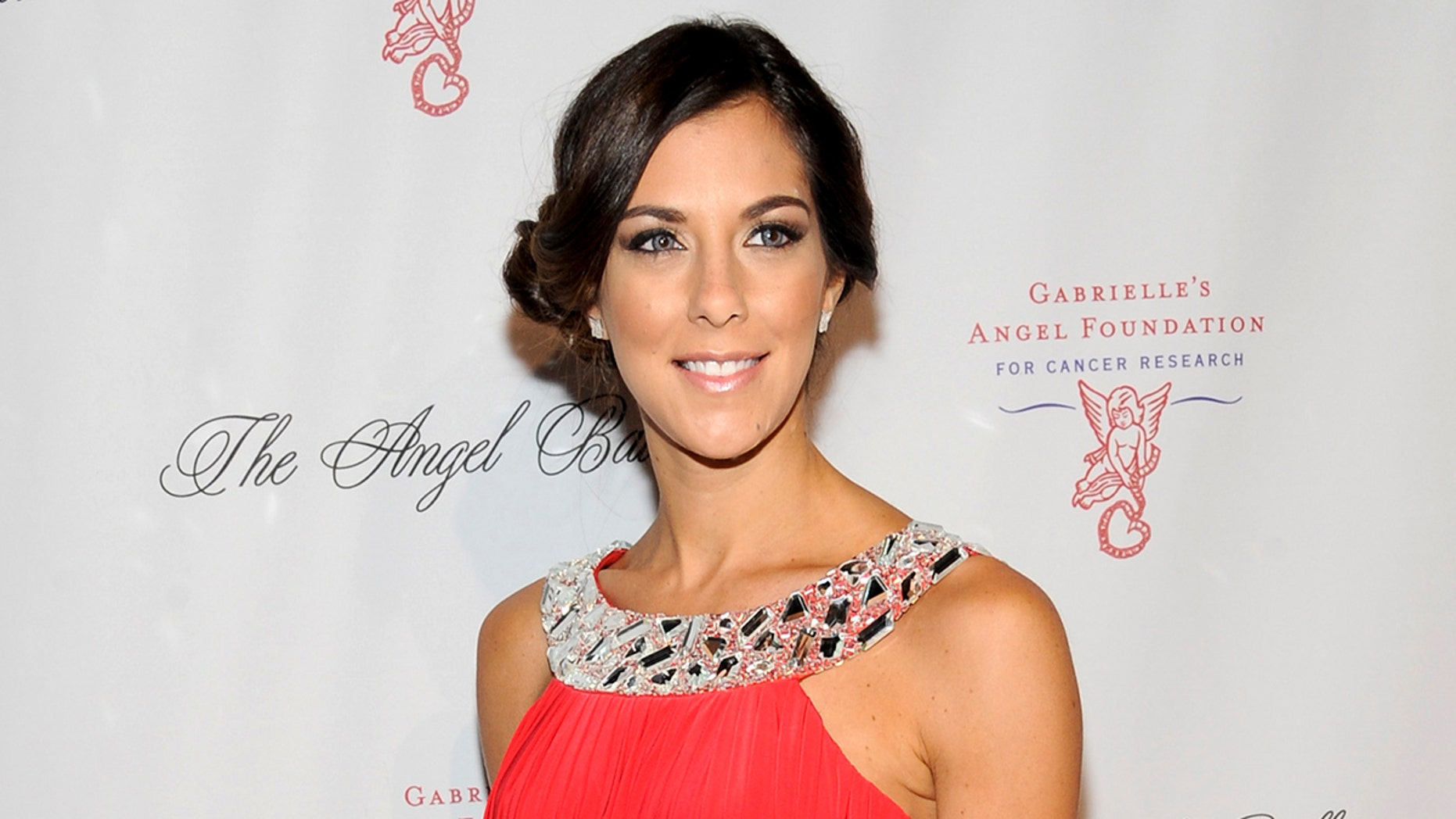 """FILE - In this Oct. 17, 2011 file photo, reality TV personality Jenna Morasca attends the Gabrielle's Angel Foundation for Cancer Research Angel Ball honors gala in New York. Police say Morasca, a winner of the reality TV show """"Survivor,"""" bit a police officer after being found unconscious in her parked car and revived with the opioid overdose antidote Narcan. A police report obtained by the Observer-Reporter newspaper says the 37-year-old became combative during the Jan. 25 incident near a McDonalds restaurant 30 miles south of Pittsburgh. (AP Photo/Evan Agostini, File)"""