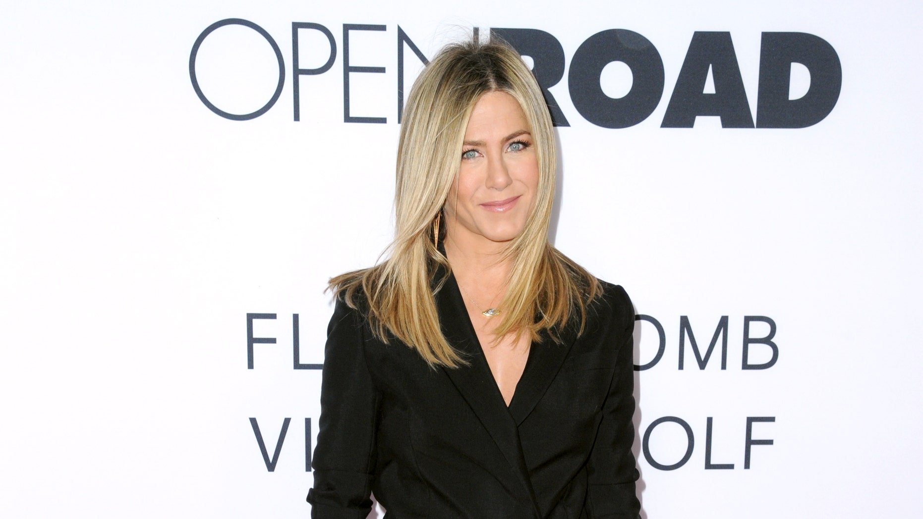 """Jennifer Aniston arrives at the Los Angeles premiere of """"Mother's Day"""" at the TCL Chinese Theatre on Wednesday, April 13, 2016. (Photo by Richard Shotwell/Invision/AP)"""