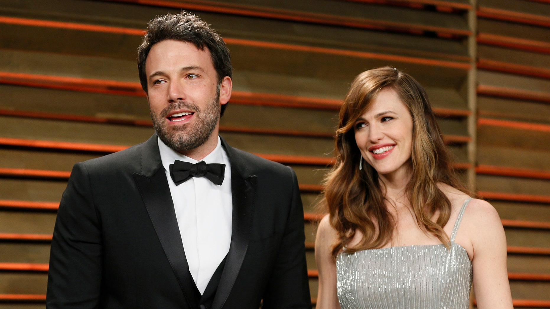 ctor Ben Affleck and his wife, actress Jennifer Garner arrive at the 2014 Vanity Fair Oscars Party in West Hollywood, California March 2, 2014.