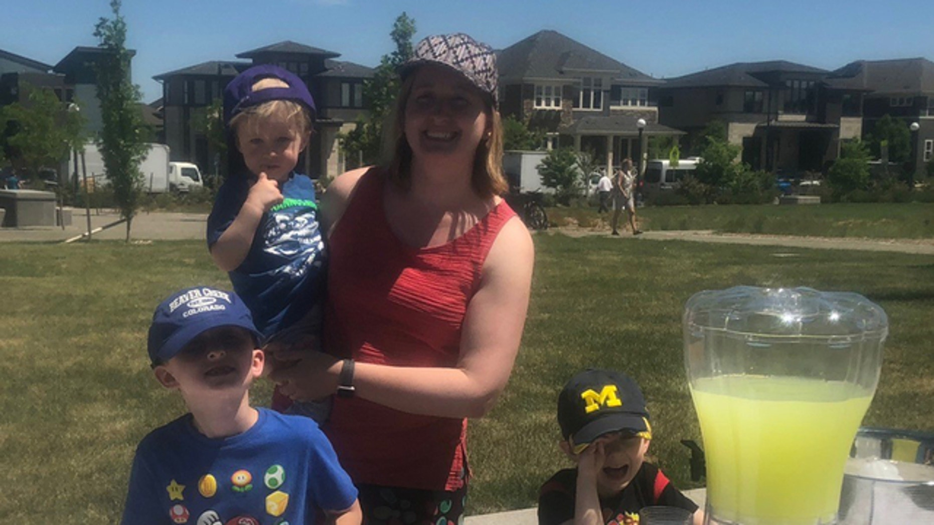 Jennifer Knowles, shown with her sons, says a neighbor complained about her the boys' lemonade stand.