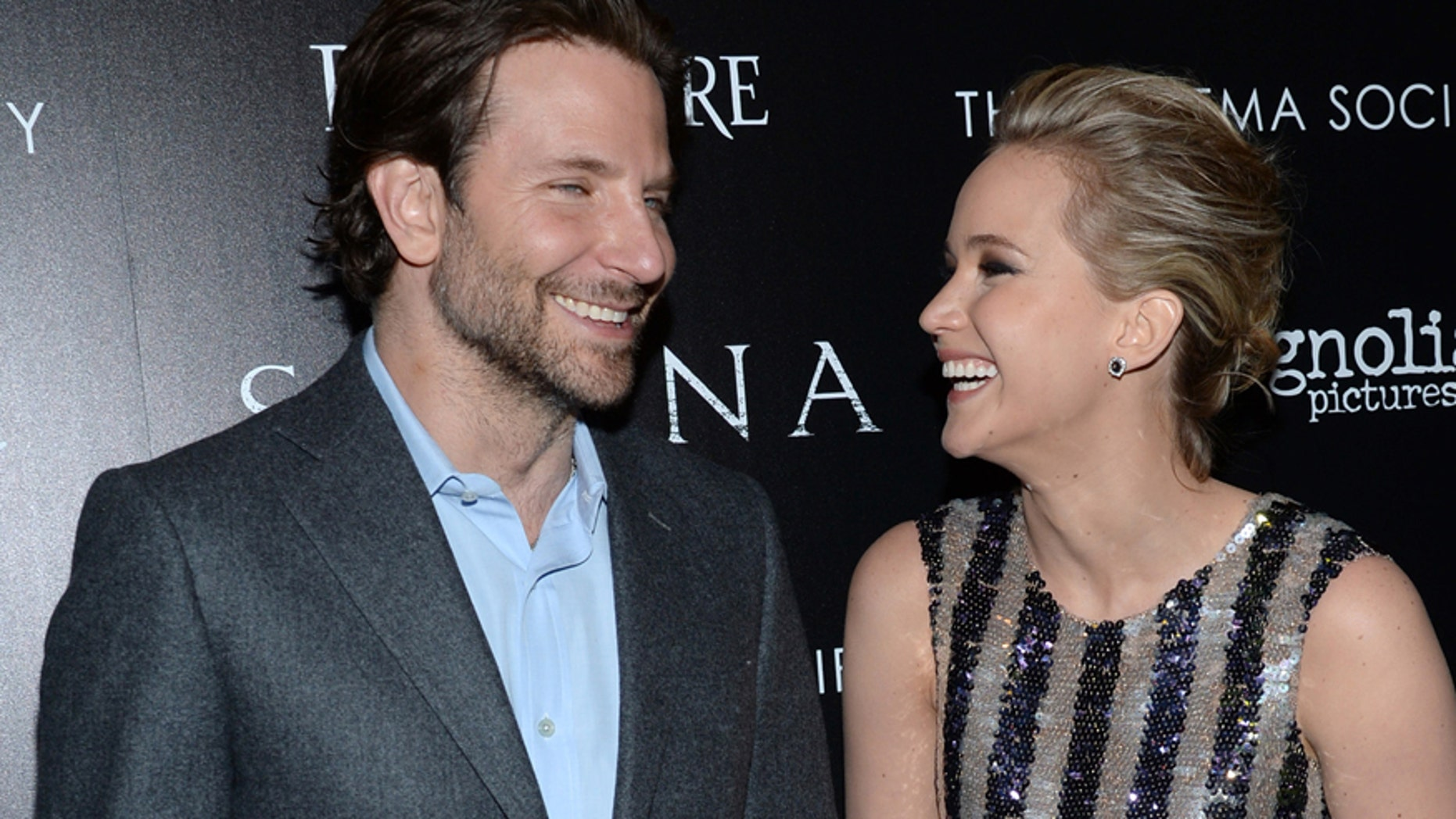 """Bradley Cooper, left, and Jennifer Lawrence arrive at a special screening of """"Serena"""", hosted by The Cinema Society and Dior Beauty, at the Landmark Sunshine Cinema on Saturday, March, 21, 2015, in New York. (Photo by Evan Agostini/Invision/AP)"""