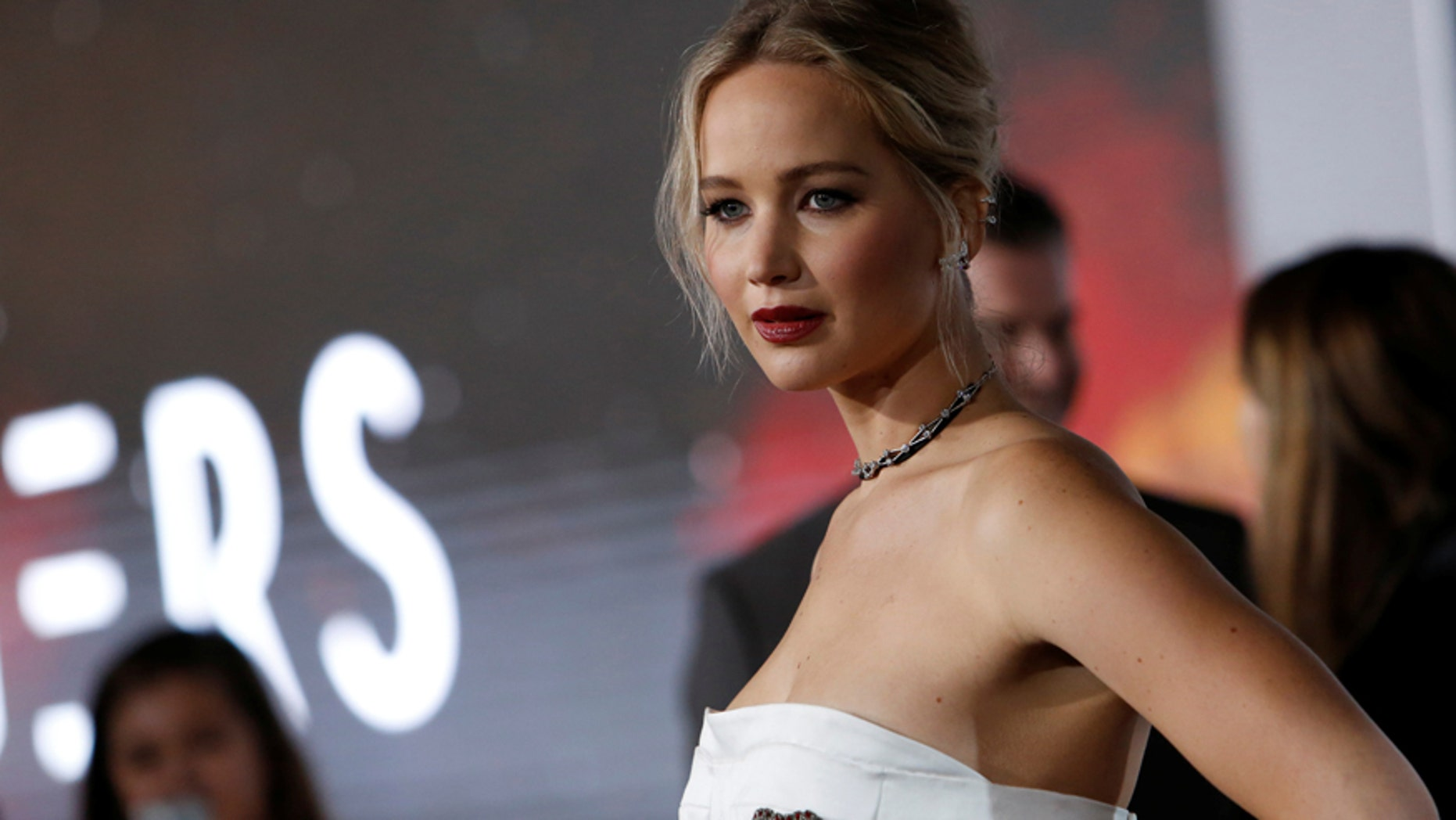 Cast Member Jennifer Lawrence Poses At The Premiere Of Passengers In Los Angeles