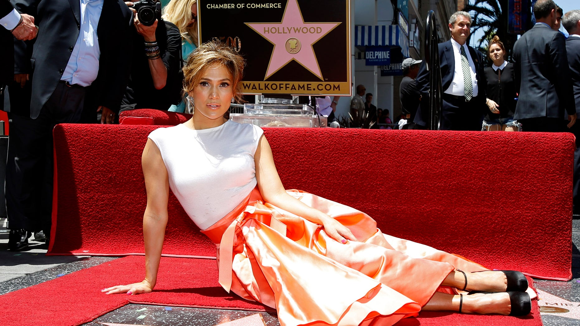 June 20, 2013. Jennifer Lopez poses on her star after it was unveiled on the Walk of Fame in Hollywood, California.