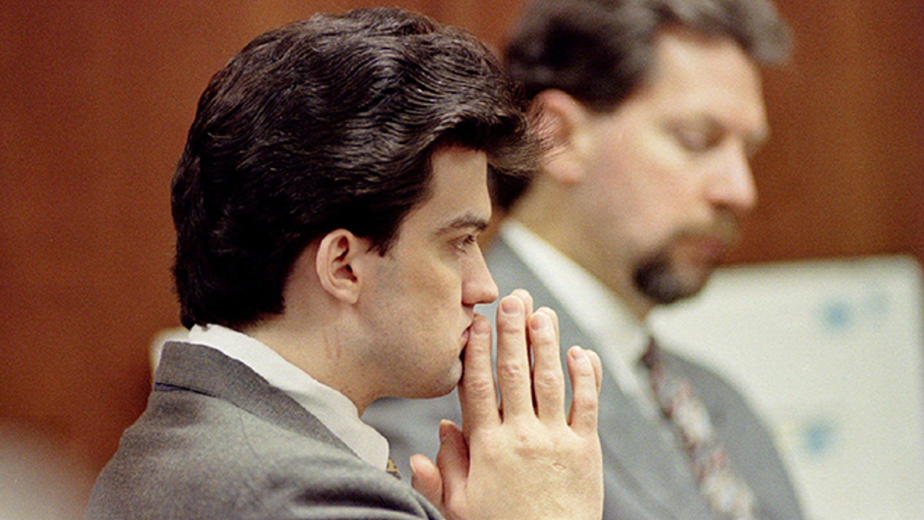Jonathan Schmitz listening to testimony during his murder trial at the Oakland County Court November 5, 1996.