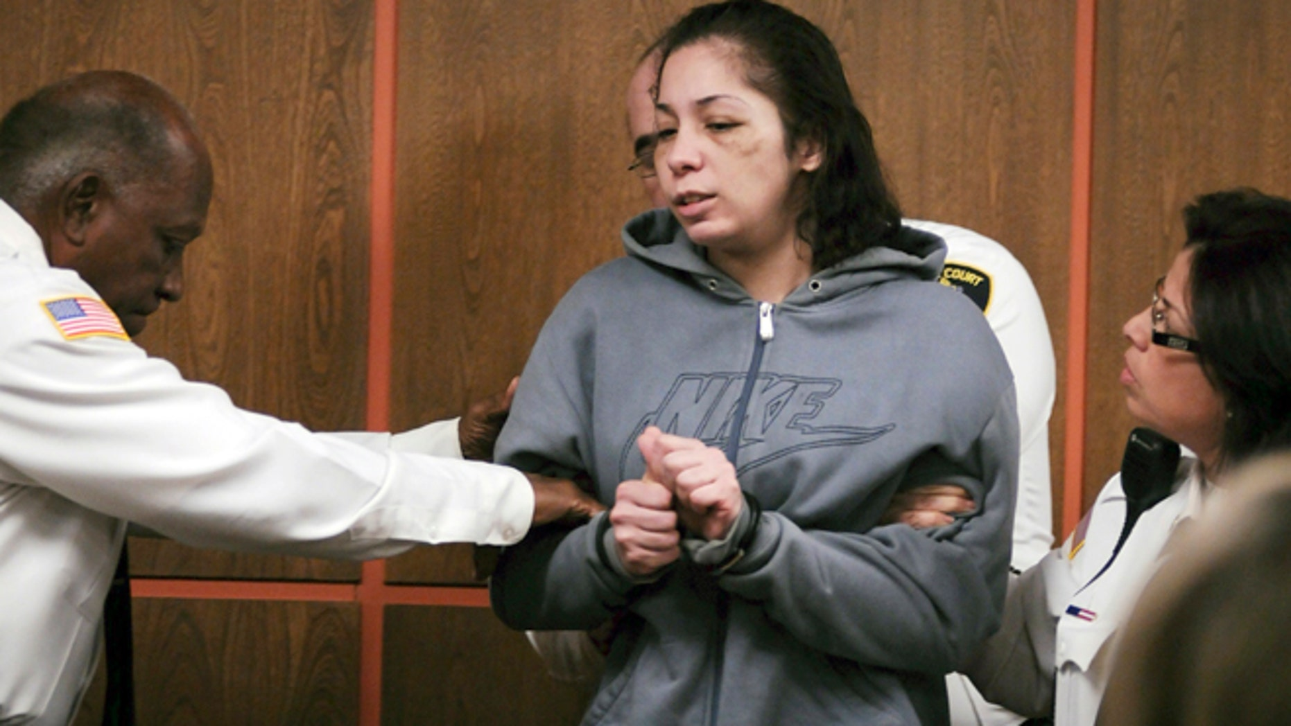 Dec. 17, 2013: Elsa Oliver is escorted into the courtroom for her arraignment in Fitchburg District Court, in Fitchburg, Mass., on charges of reckless endangerment of a child and accessory after the fact of assault, in regards to her missing 5-year-old son, Jeremiah Oliver.