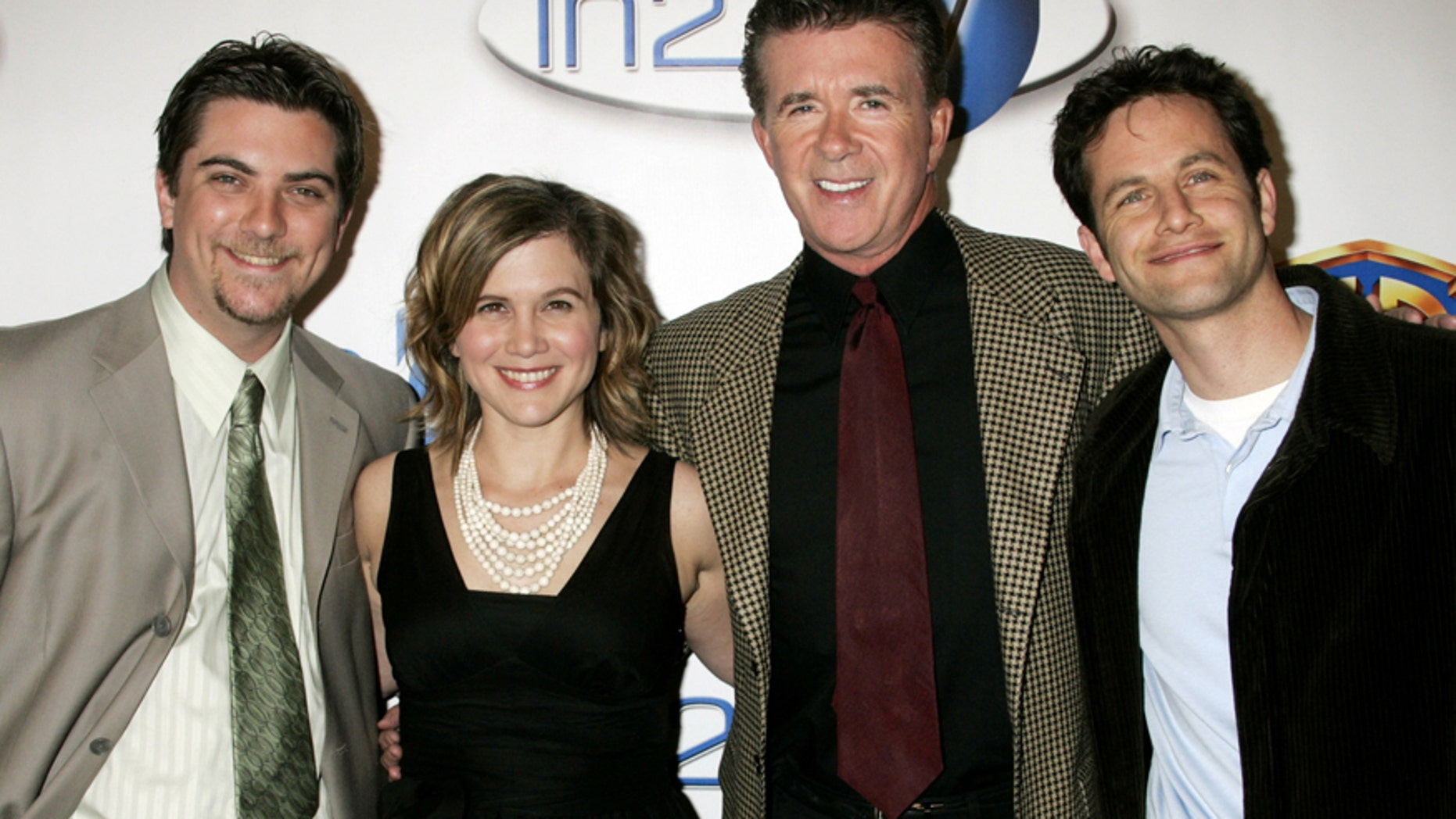 Actors (L-R) Jeremy Miller, Tracey Gold, Alan Thicke and Kirk Cameron best known for their portrayal of a family on the 'Growing Pains' television series pose as they arrive at the launch party for In2TV in Beverly Hills, California  March 15, 2006. The network offers the largest collection of free on-demand shows on the Web.