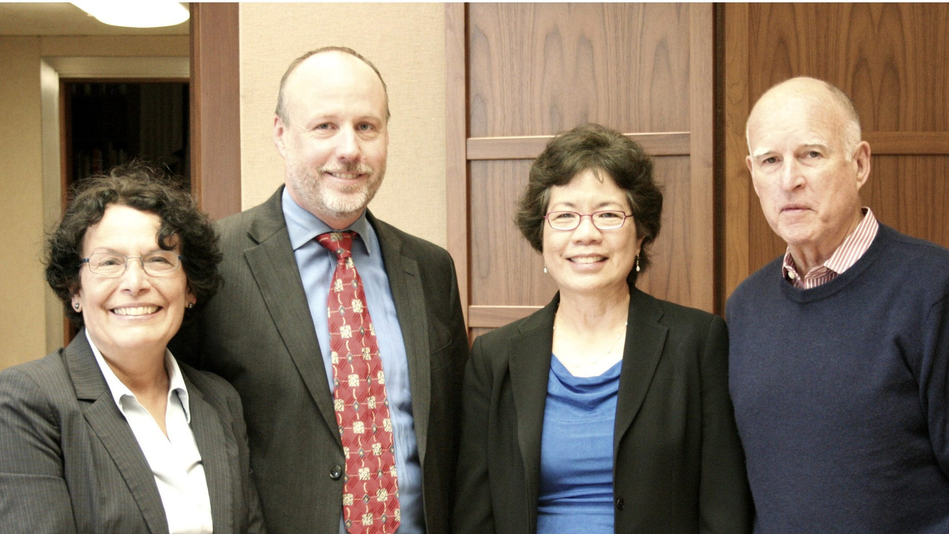 Newly appointed Cal/OSHA Chief Juliann Sum with (pictured left to right) CA Department of Industrial Relations Director Christine Baker, CA Labor and Workforce Development Agency Secretary David Lanier, and Governor Edmund G. Brown Jr.