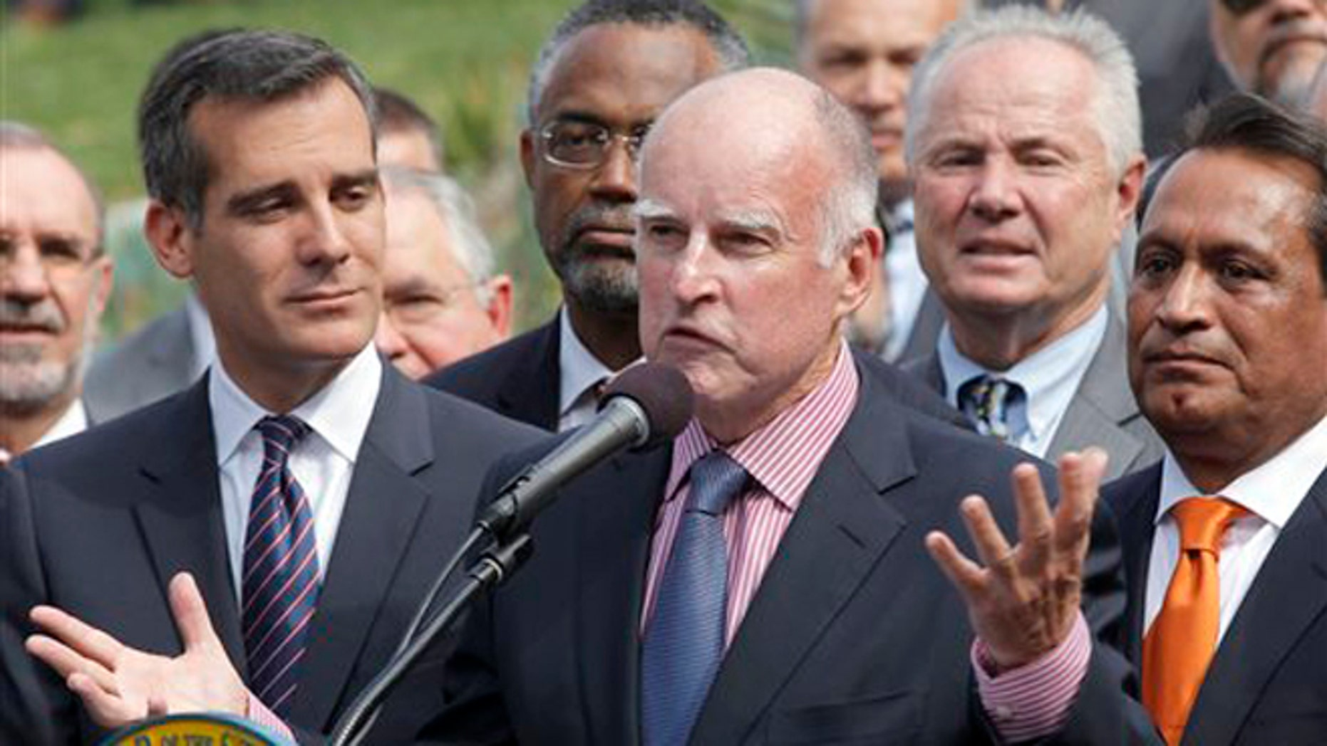 California Gov. Jerry Brown speaks at Los Angeles City Hall before signing the AB 60  bill in Los Angeles Thursday, Oct 3, 2013. The bill adds California to the growing list of states allowing immigrants in the country illegally to obtain driver licenses. (AP Photo/Nick Ut)