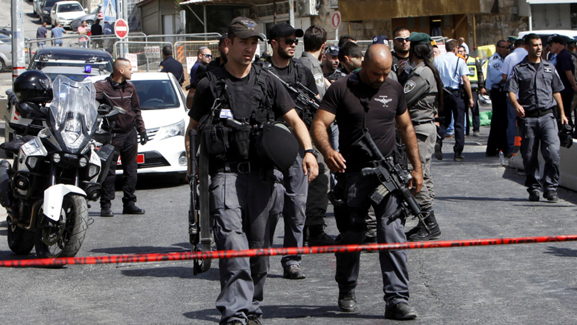 Oct. 9, 2016: Israeli police secures the scene where a car driven by a Palestinian gunman was intercepted by the police and gunman shot dead in Jerusalem.