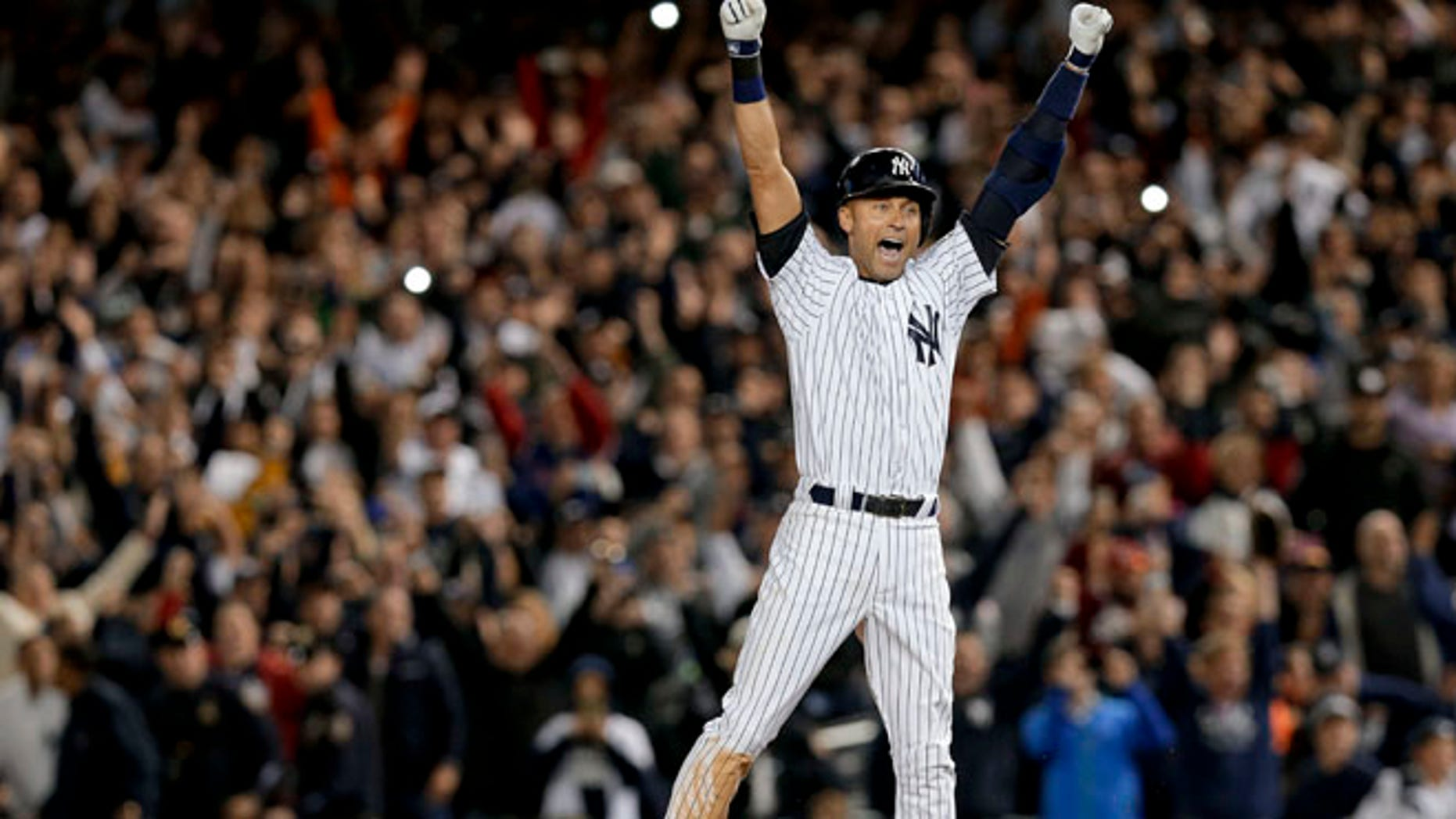 Sept. 25, 2014: New York Yankees' Derek Jeter jumps after hitting the game-winning single against the Baltimore Orioles in the ninth inning of a baseball game in New York. (AP)
