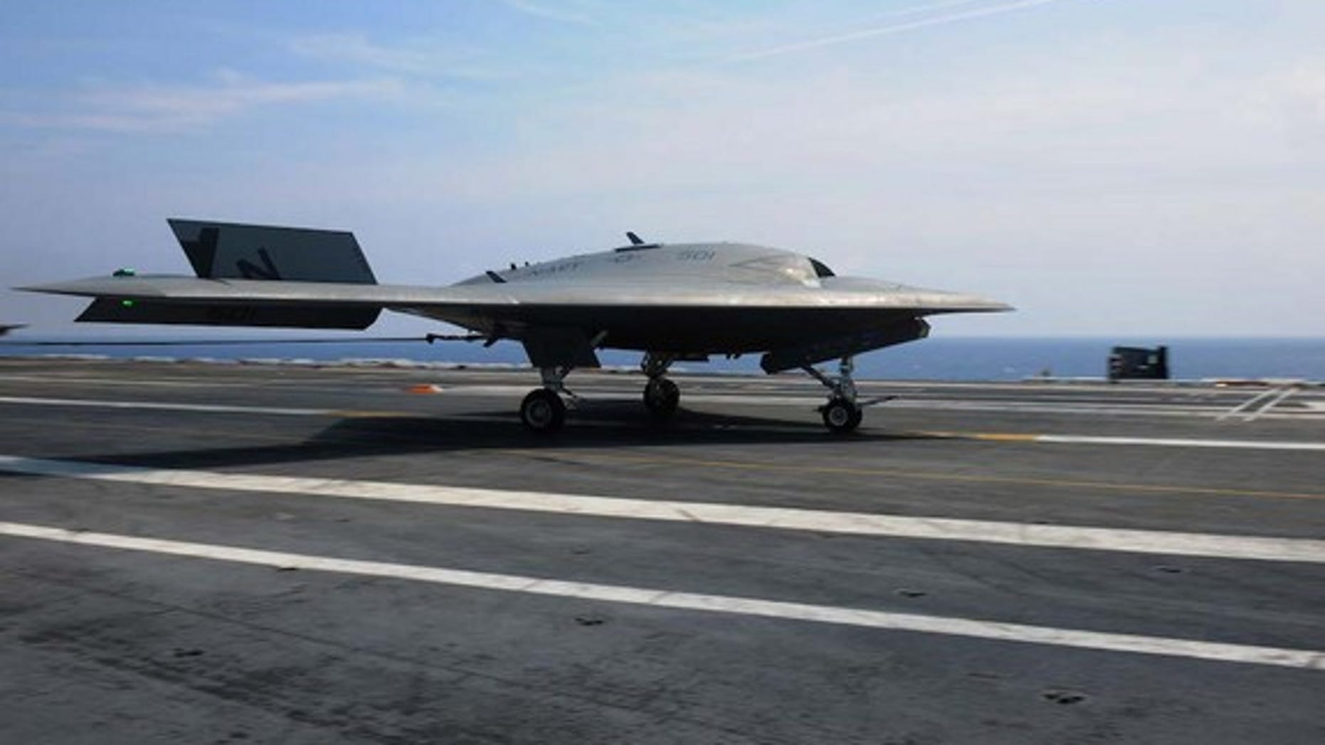 The U.S. Navy's unmanned X-47B  lands aboard the USS Theodore Roosevelt.