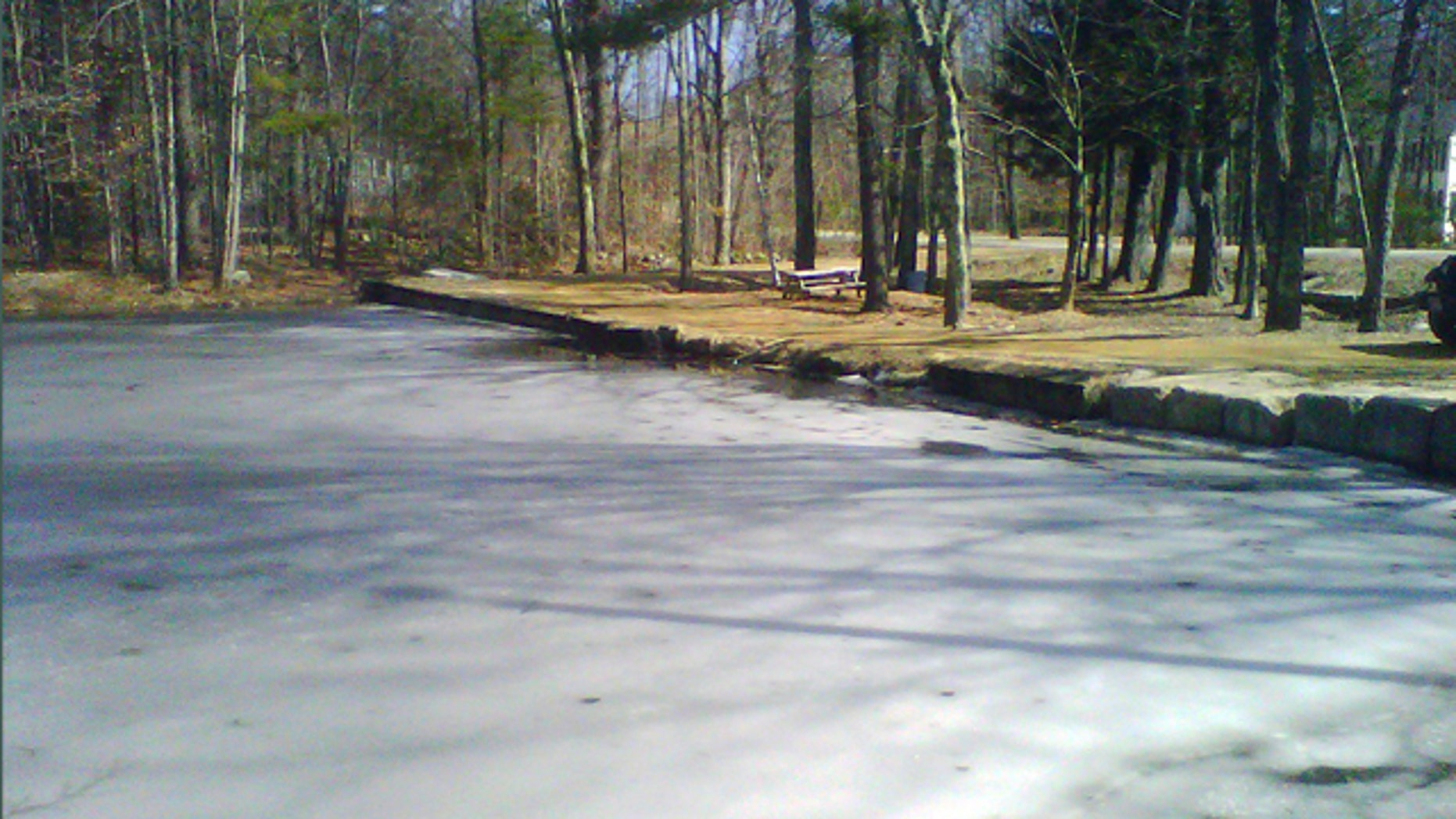 March 12, 2012: Ice partially covers the surface of Jew Pond in Mont Vernon, N.H. Residents can vote at a town meeting Tuesday whether to petition to officially change the name, which appears on a 1968 map but not on any town signs. Some say the name is inappropriate and disrespectful. Others says it was never meant to be offensive and is part of the towns history.