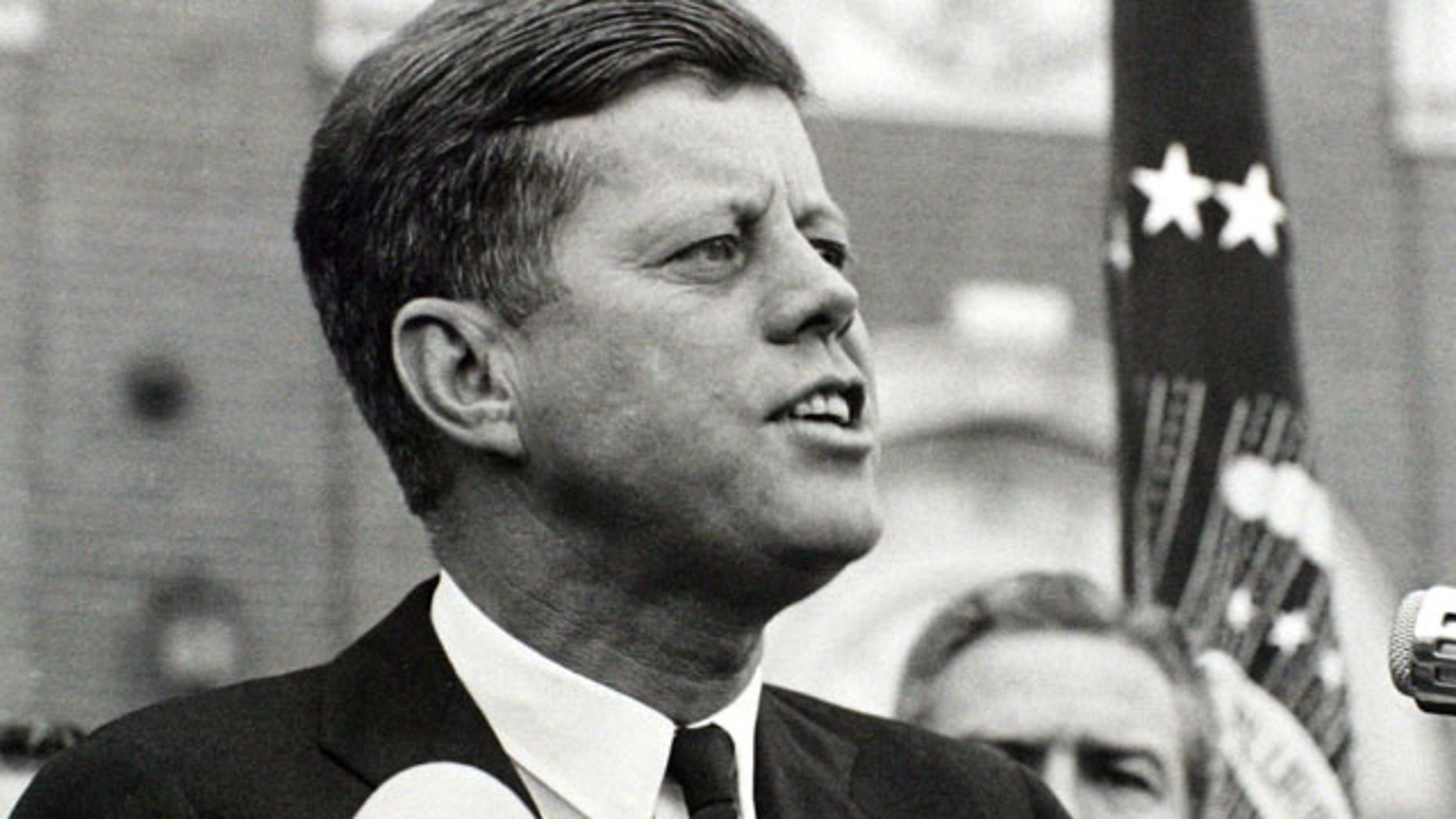 President John F. Kennedy delivers a speech at a rally in Fort Worth, Texas several hours before his assassination.