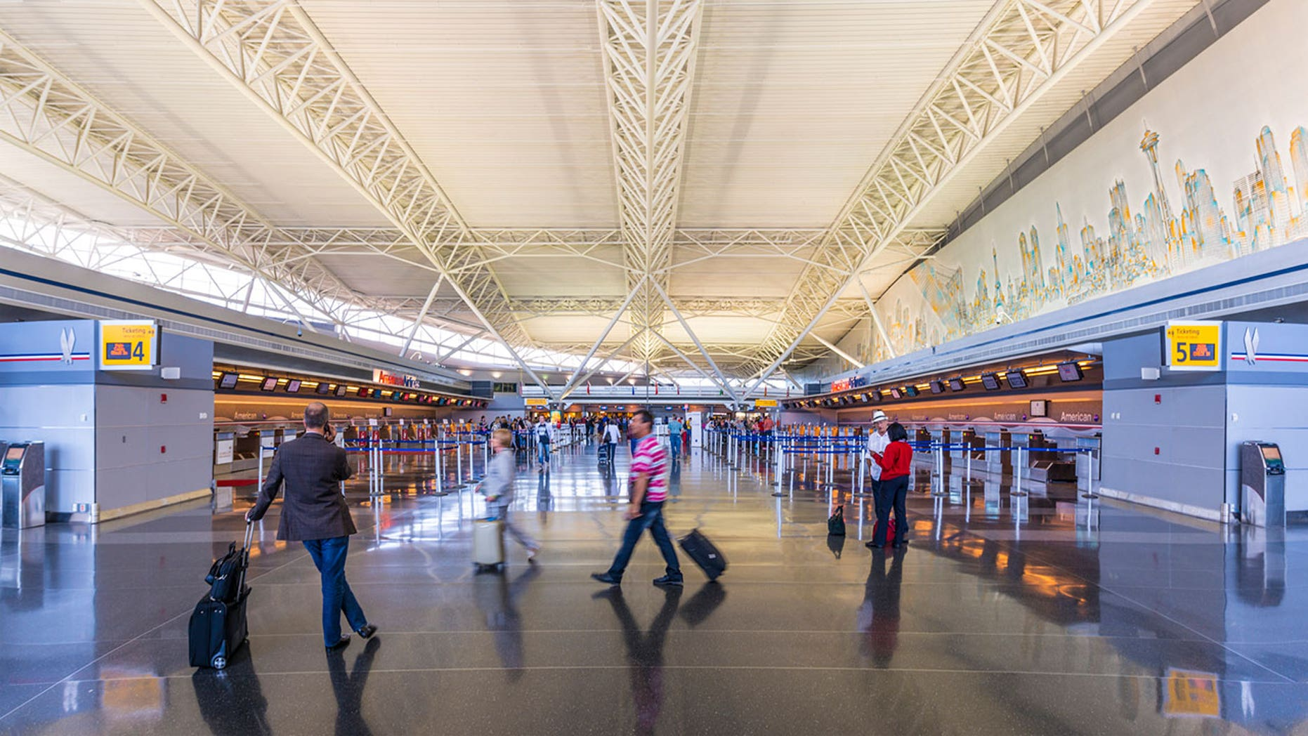 Workers at four major airports, including JFK (above), were planning to strike, citing unfair labor conditions.