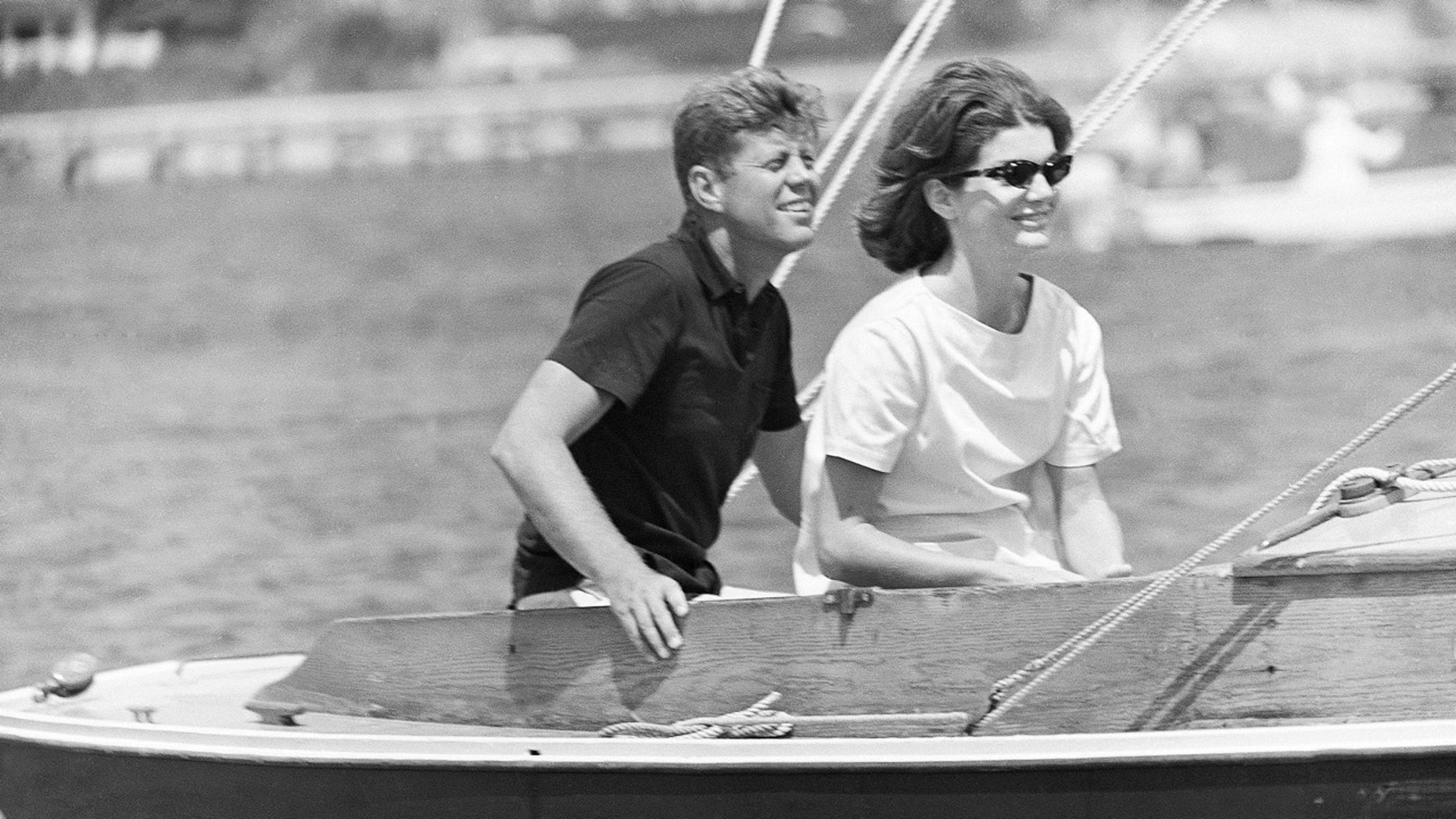 In this Aug. 7, 1960 file photo, then-Sen. John F. Kennedy and wife Jacqueline sail in the family sailboat, Victura, off the Cape Cod shore at Hyannis, Mass.