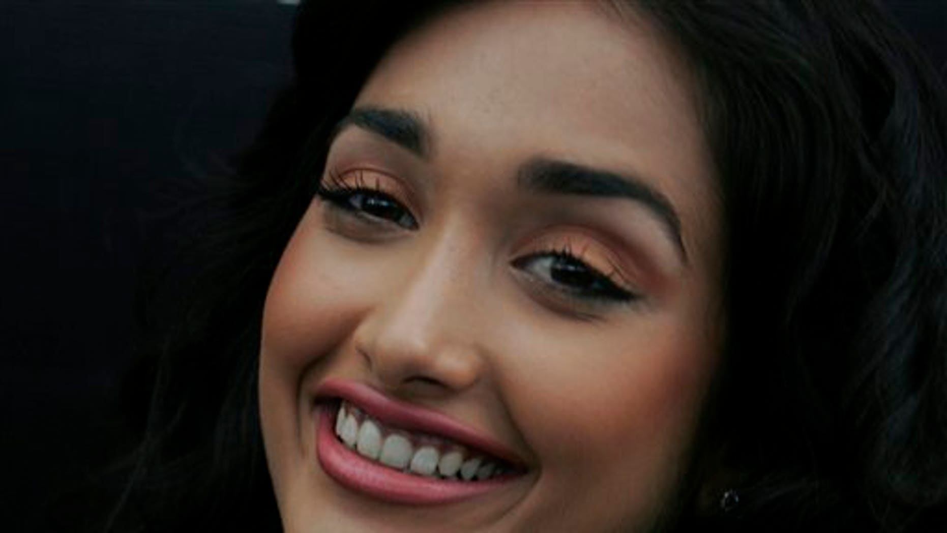 """In this Dec. 19, 2008 file photo, Bollywood actress Jiah Khan smiles during a promotional event of her forthcoming Hindi movie """"Ghajini"""" in Bangalore, India. Police said that Khan was found dead at her home in Mumbai late Monday, June 3, 2013."""