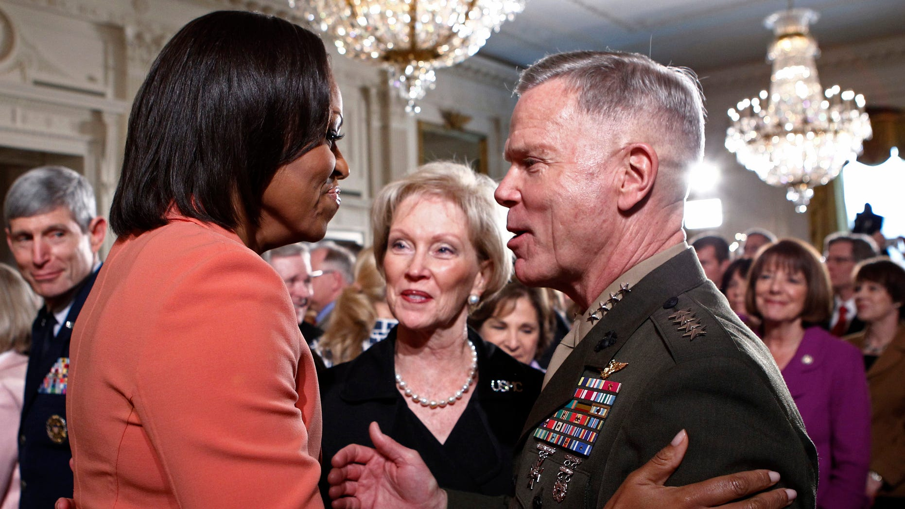 April 12, 2011: U.S. first lady Michelle Obama (L) talks with General James Amos (R) in the East Room at the White House.