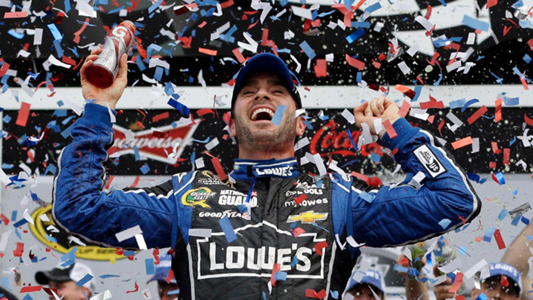 Feb. 24, 2013: Jimmie Johnson celebrates in Victory Lane after winning the NASCAR Daytona 500 Sprint Cup Series auto race at Daytona International Speedway in Daytona Beach, Fla.