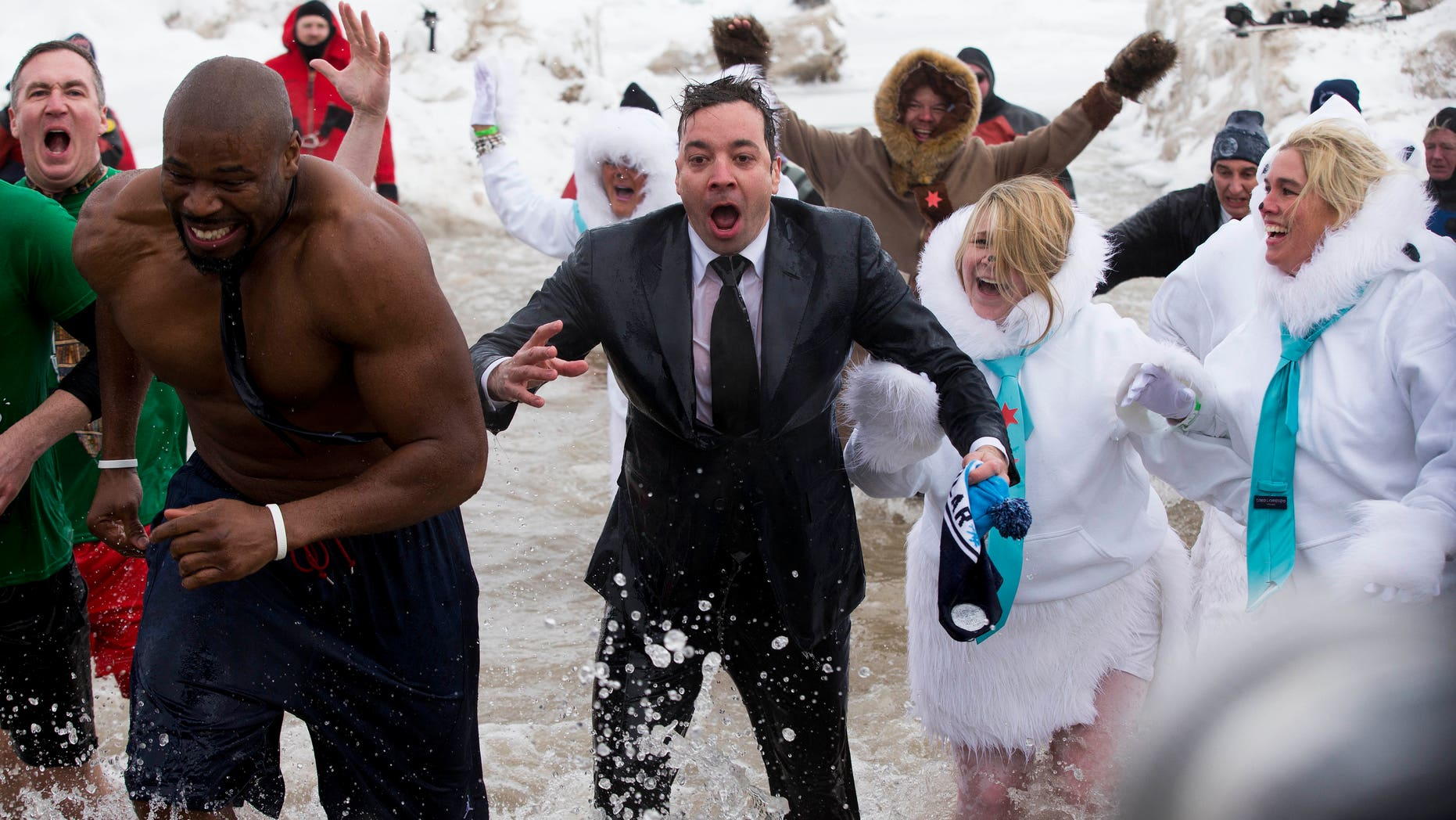 """March 2, 2014. """"The Tonight Show"""" host Jimmy Fallon, center, exits the water during the Chicago Polar Plunge. Fallon joined Chicago Mayor Rahm Emanuel in the event."""